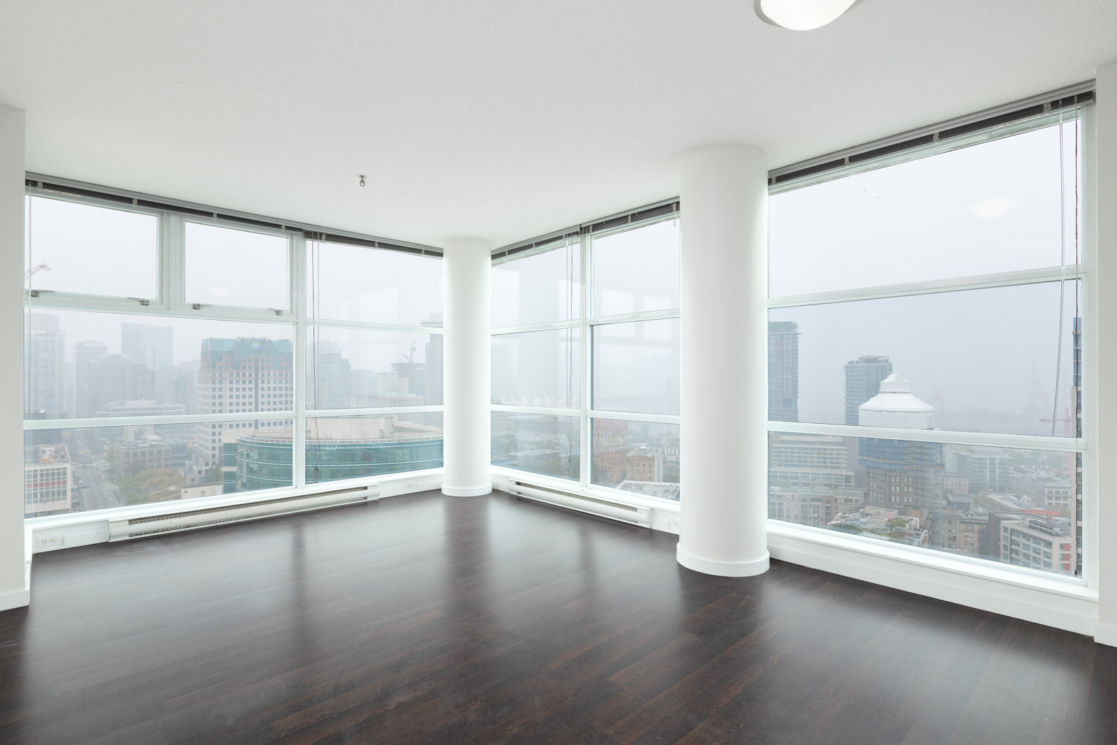living room with windows and views in rental condo at spectrum 4 building in crosstown neighbourhood of downtown vancouver
