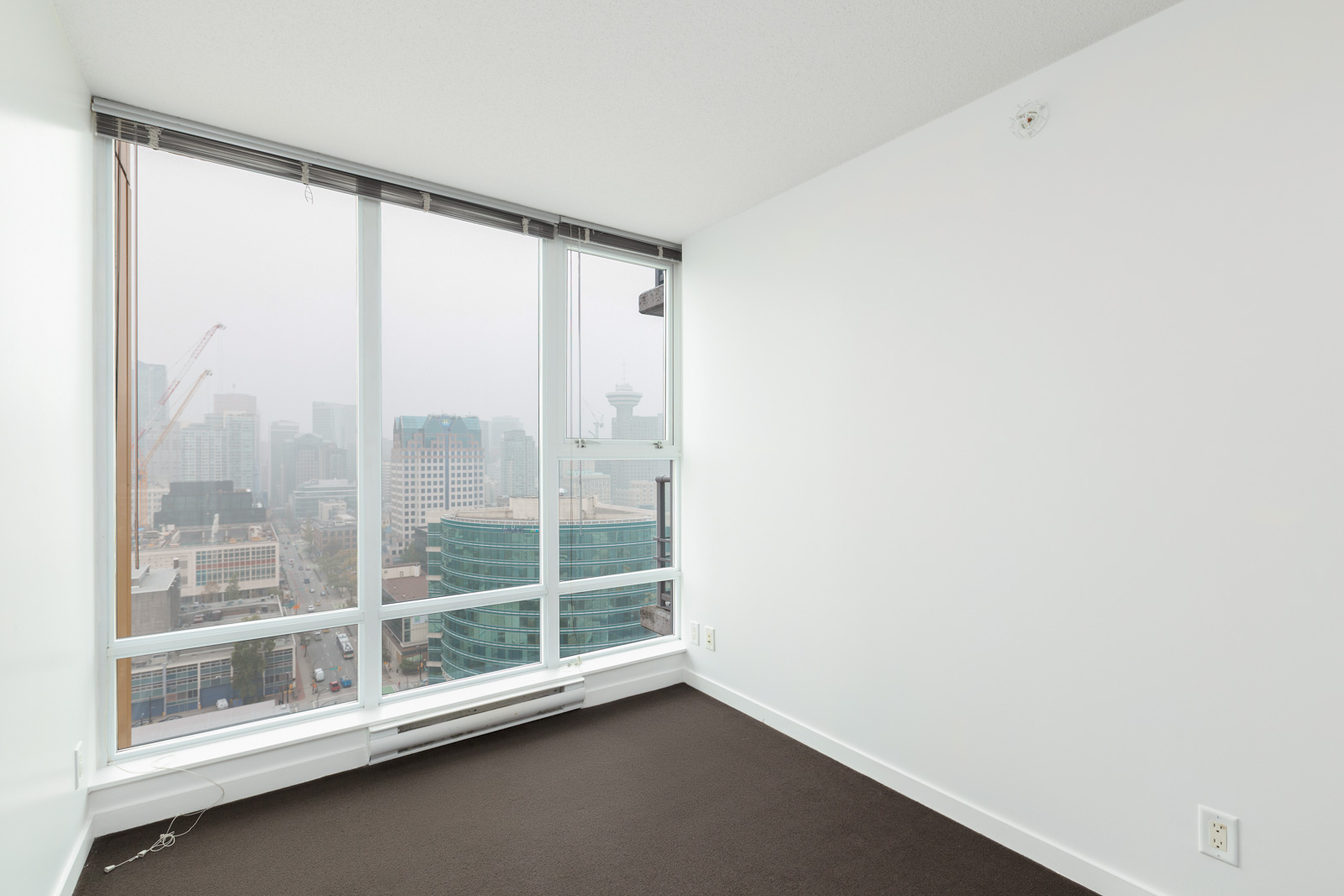 bedroom in spectrum rental condo managed by birds nest properties with window and view on a cloudy day