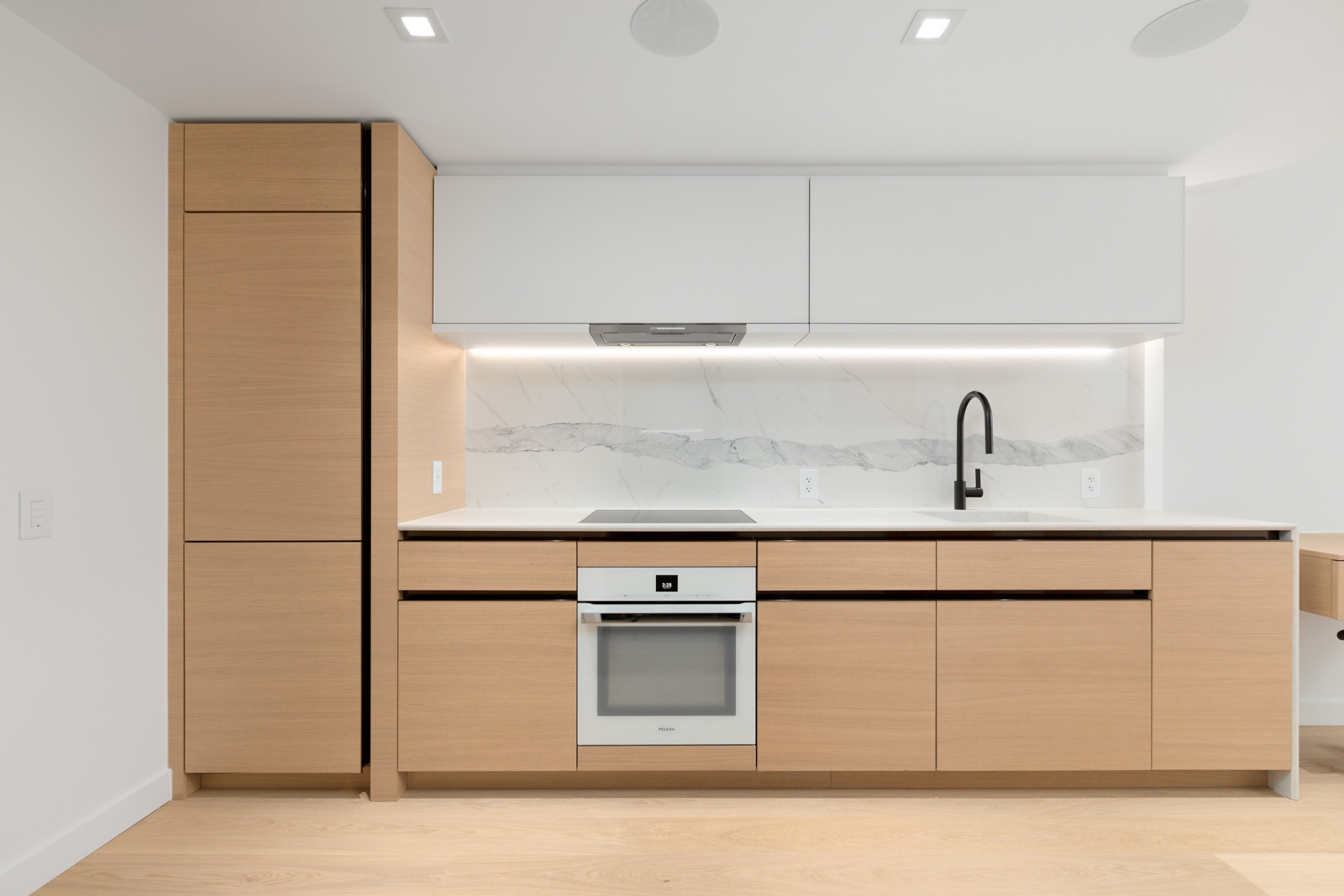 kitchen in brand new cardero building designed by henriquez partners architects in coal harbour in downtown vancouver