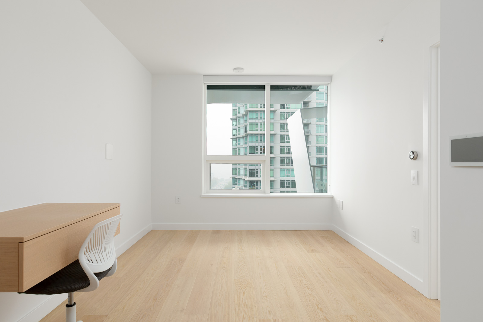 empty living room in bosa brand new cardero building designed by henriquez partners architects in coal harbour in downtown vancouver