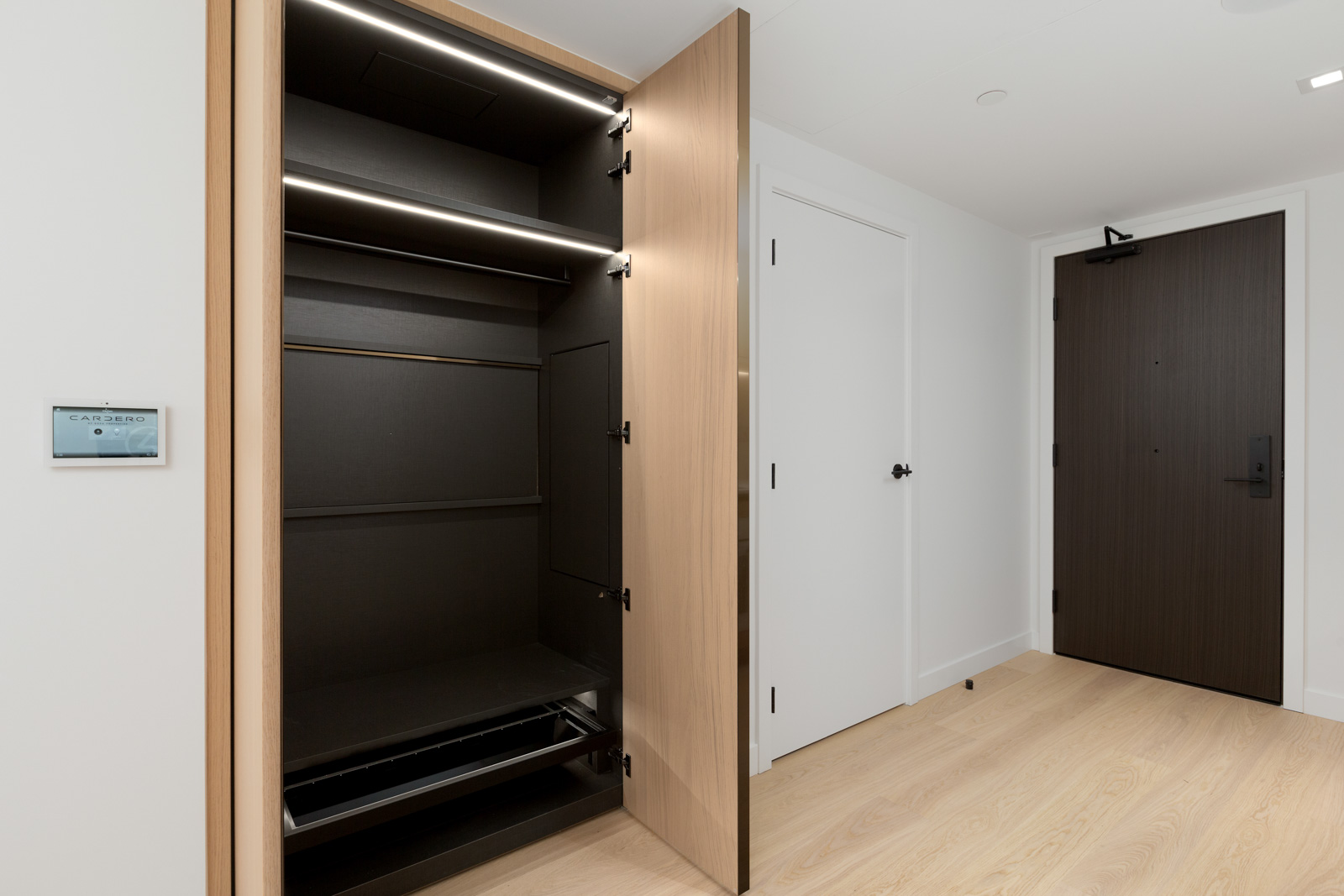 wardrobe in brand new cardero building designed by henriquez partners architects in coal harbour in downtown vancouver