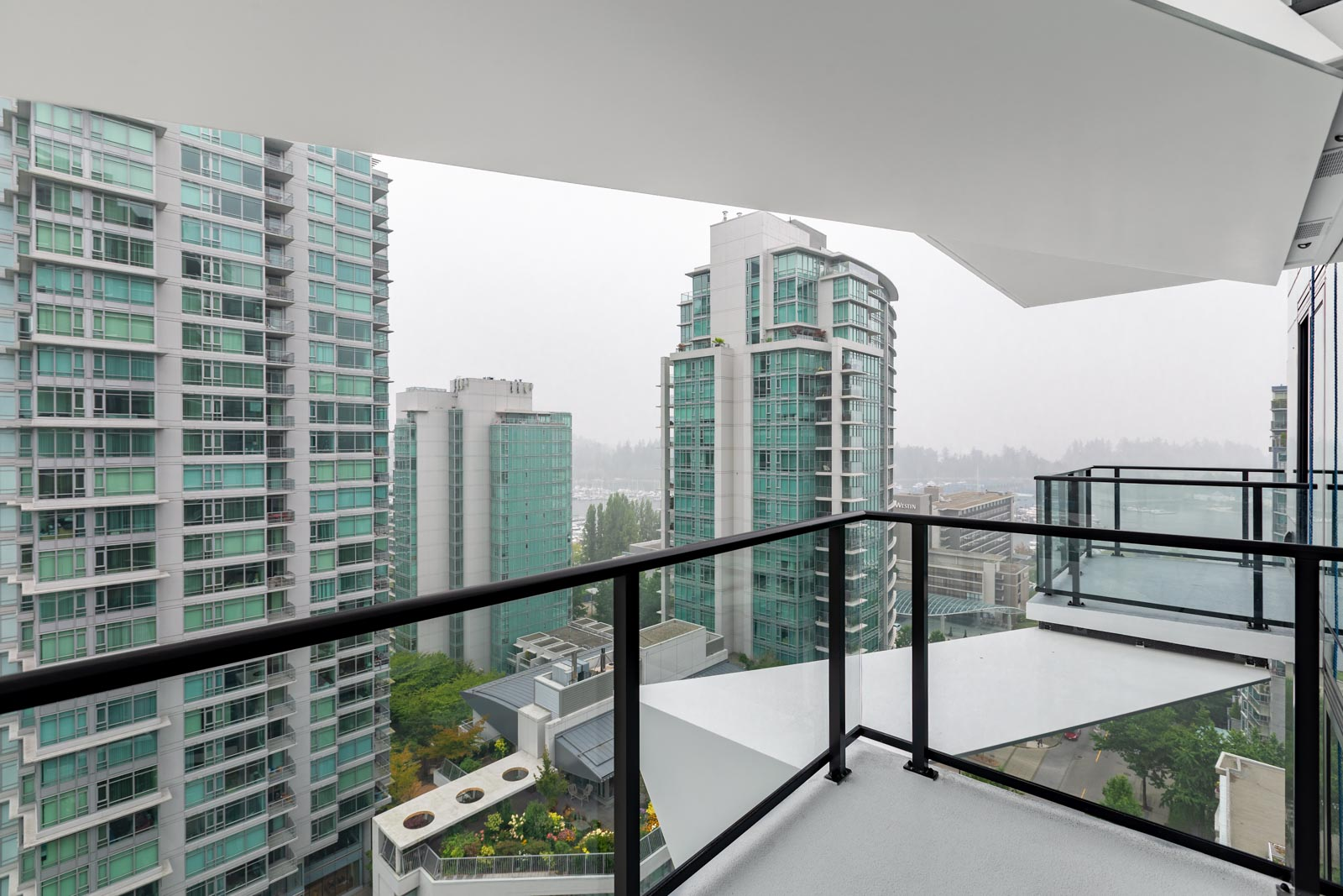 balcony with view of condo buildings of cardero building designed by henriquez partners in coal harbour neighbourhood in downtown vancouver