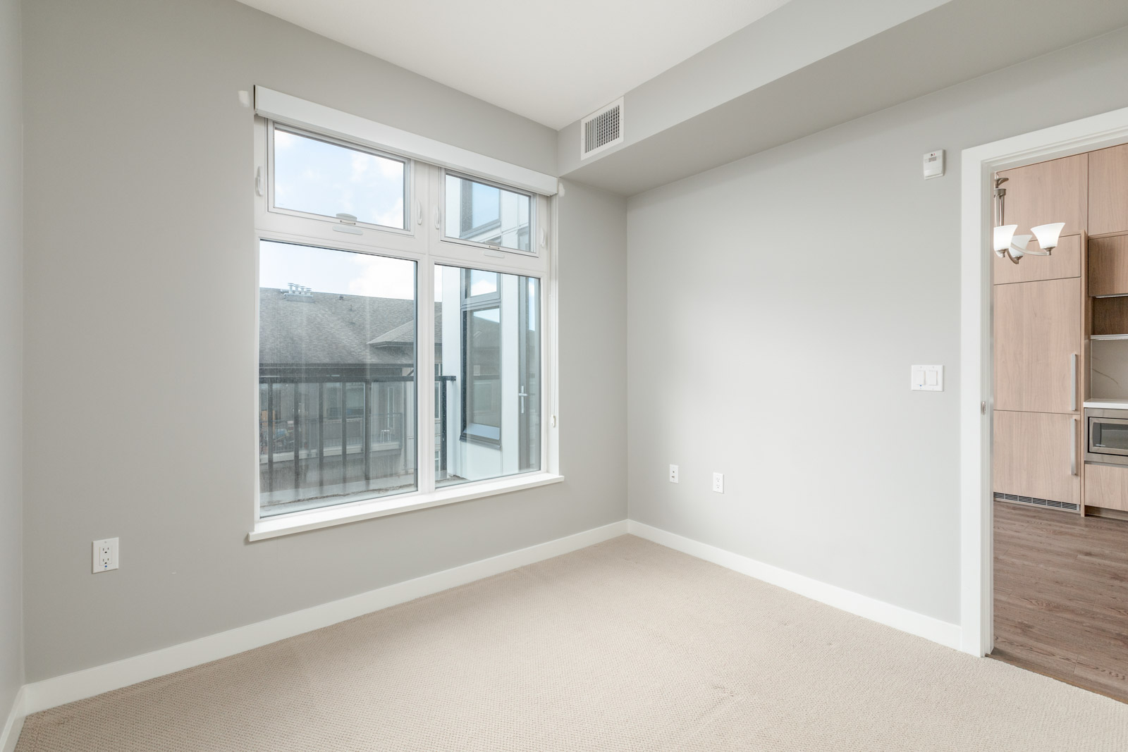 bedroom with white walls and window in rental townhome in the Cambie + Marine neighbourhood of Richmond