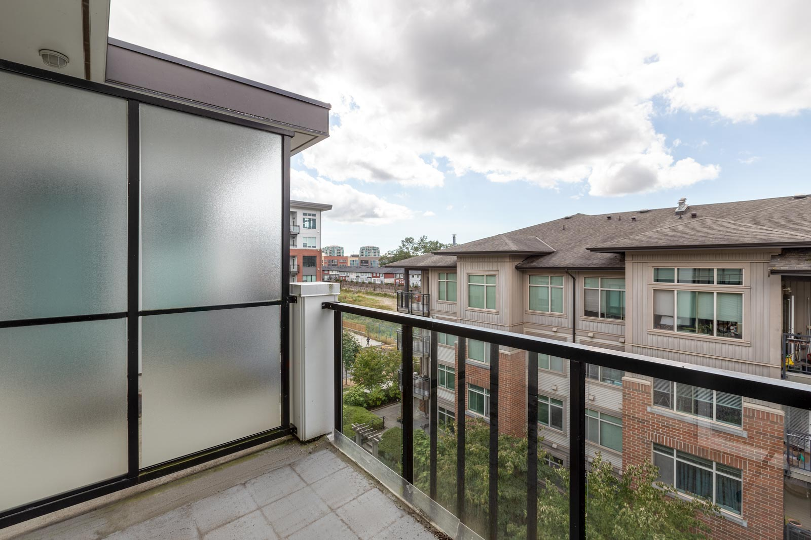 balcony with view of clear skies in rental townhome in the Cambie + Marine neighbourhood of Richmond