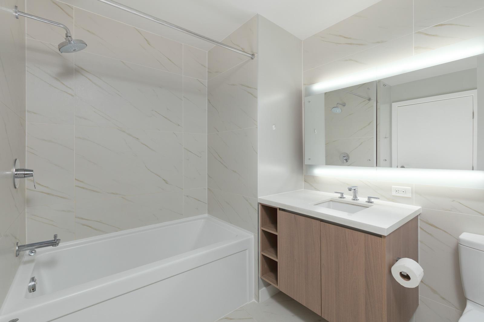 Bathroom with white walls and ceramic bath tub