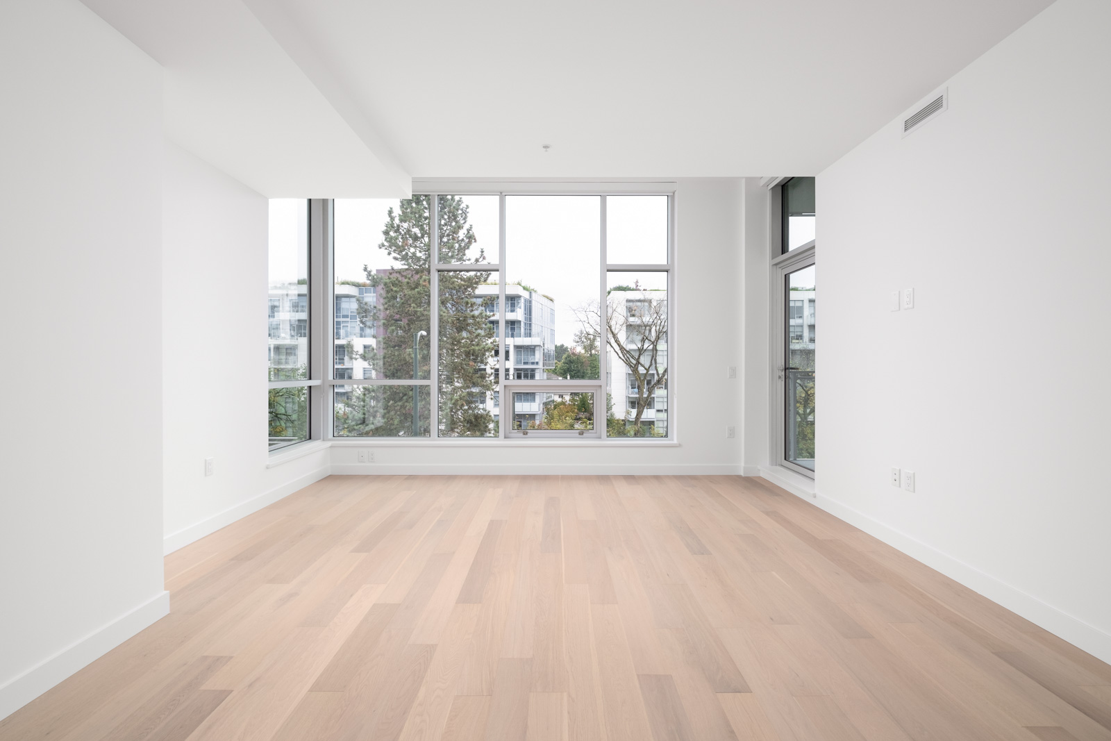 bedroom with white walls and window in rental condo in the Cambie Corridor neighbourhood of Vancouver