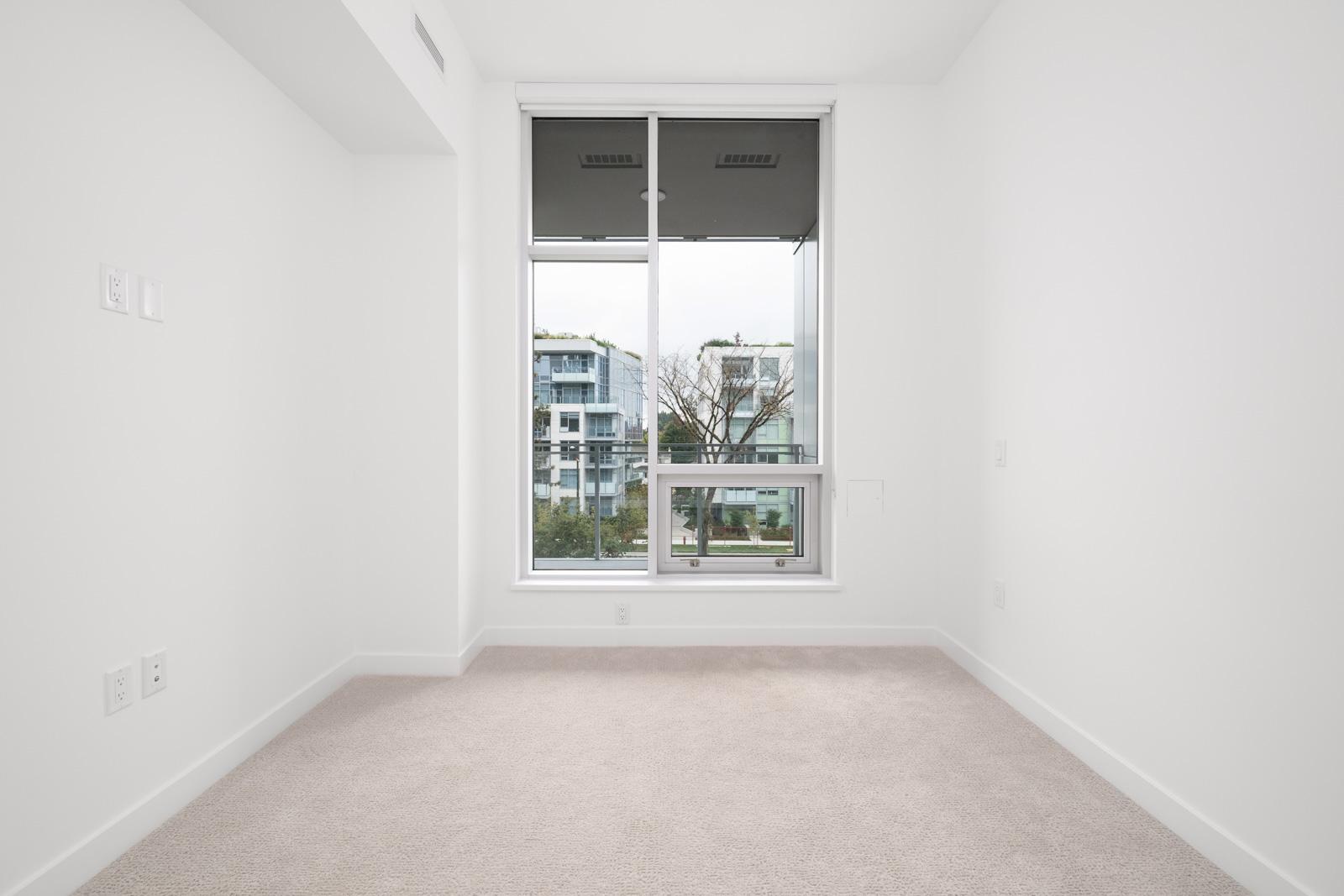 living room with hardwood floors in rental condo in the Cambie Corridor neighbourhood of Vancouver