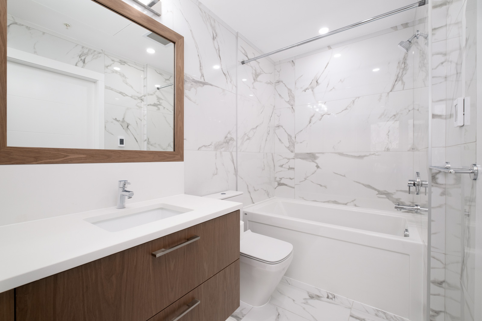 Bathroom with white walls and bath tub