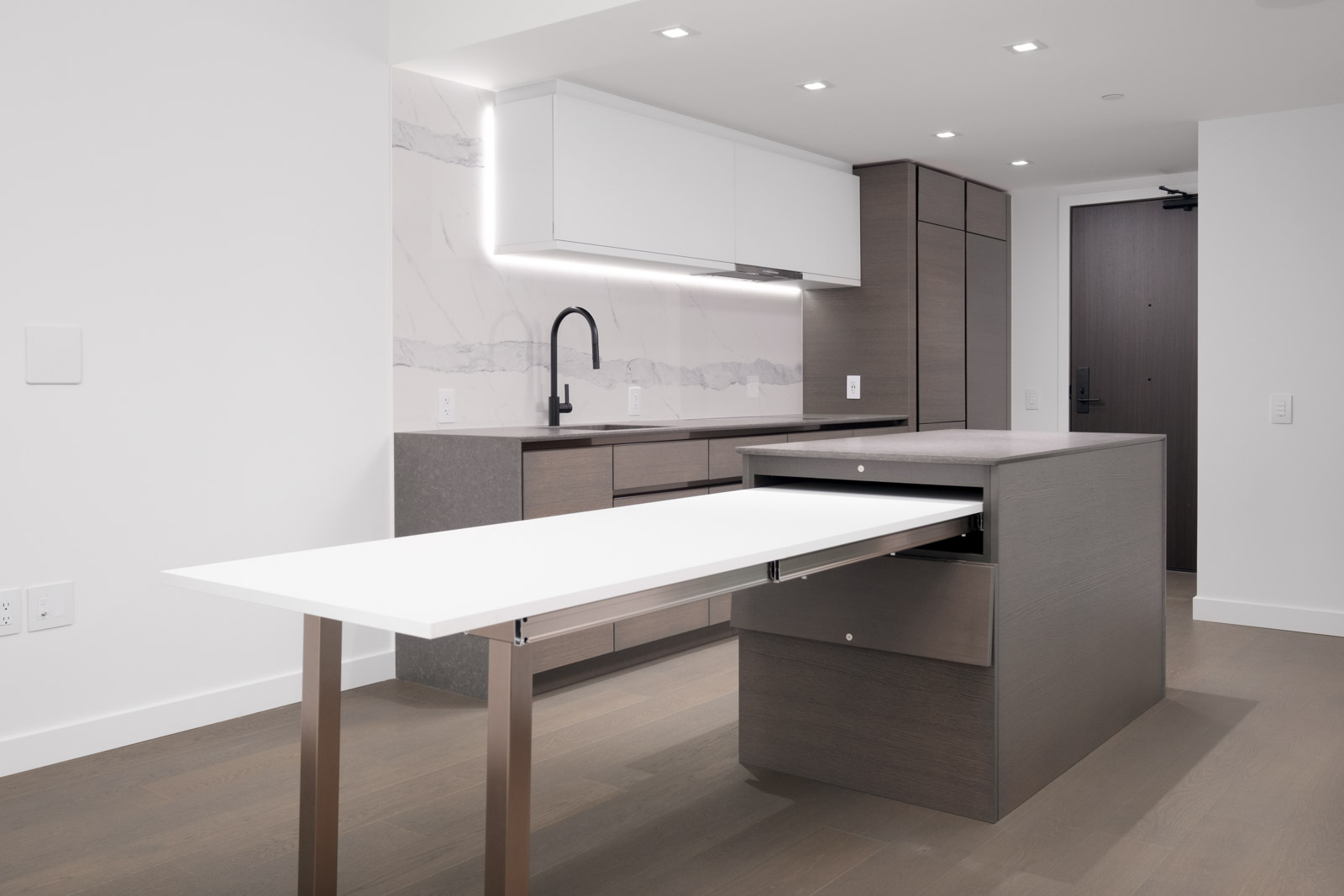 dining table extension from kitchen island in rental condo at cardero in coal harbour neighbourgood of vancouver