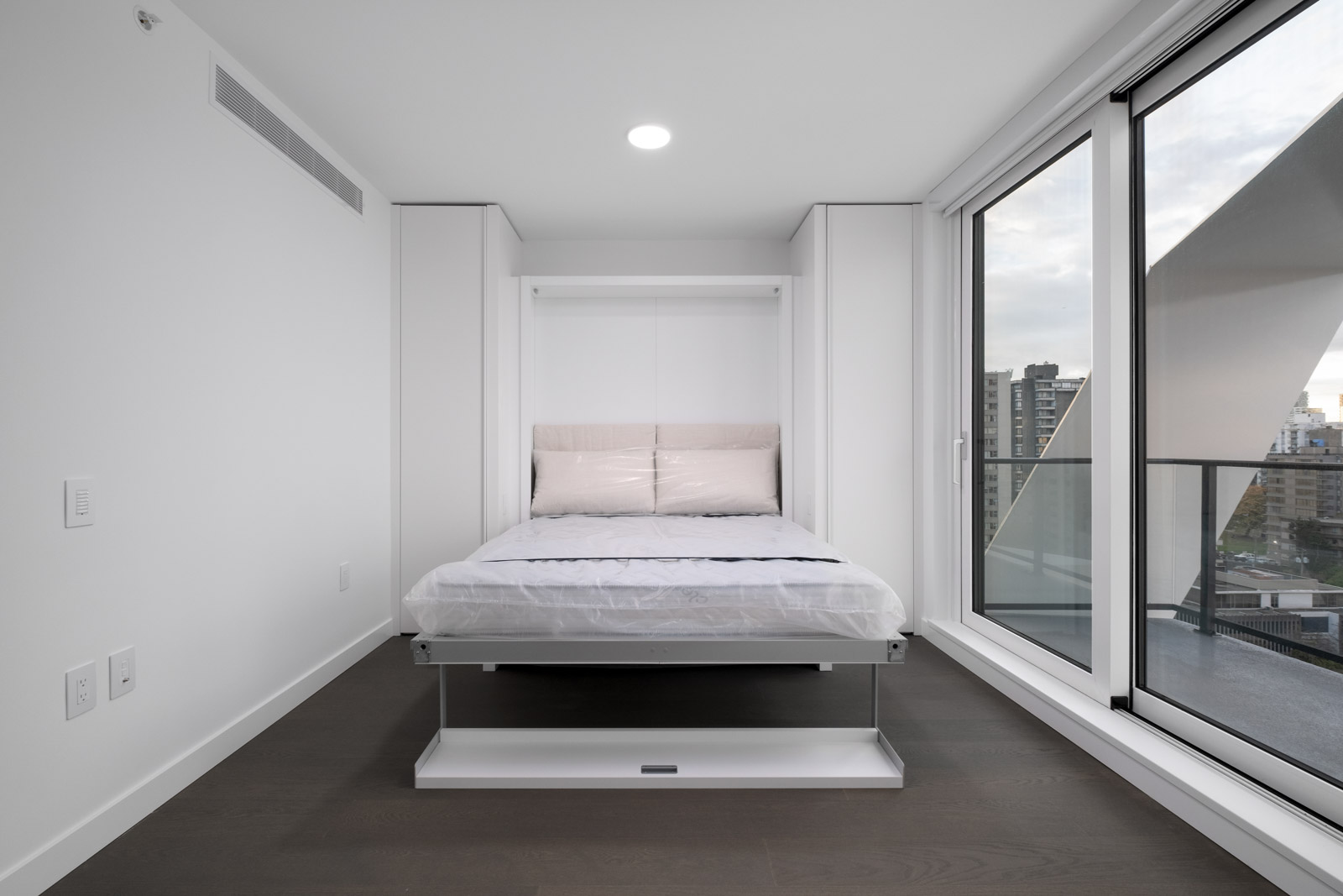 bedroom with closet in rental condo at cardero in coal harbour neighbourgood of vancouver