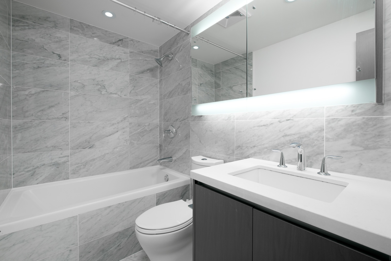 bathroom with white walls and tile floors in rental condo in the metrotown neighborhood of Burnaby