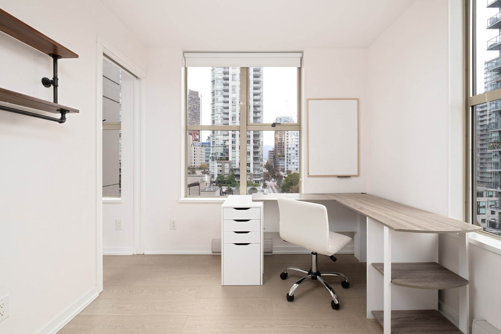 office with window desk and white filing cabinet and hardwood floors in yaletown vancouver furnished rental condo