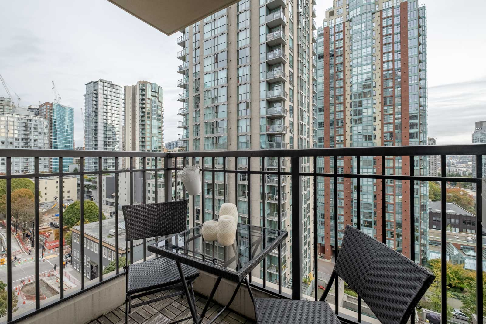 balcony with chairs and table in rental condo managed by birds nest properties at mondrian 2 building in yaletown vancouver