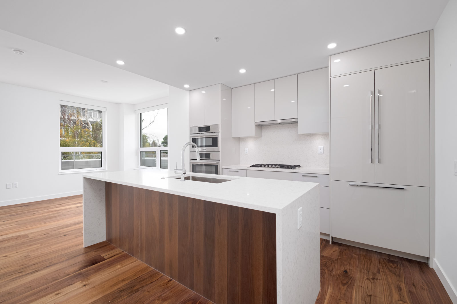 kitchen with island in brand new rental condo of basalt building in vancouver westside