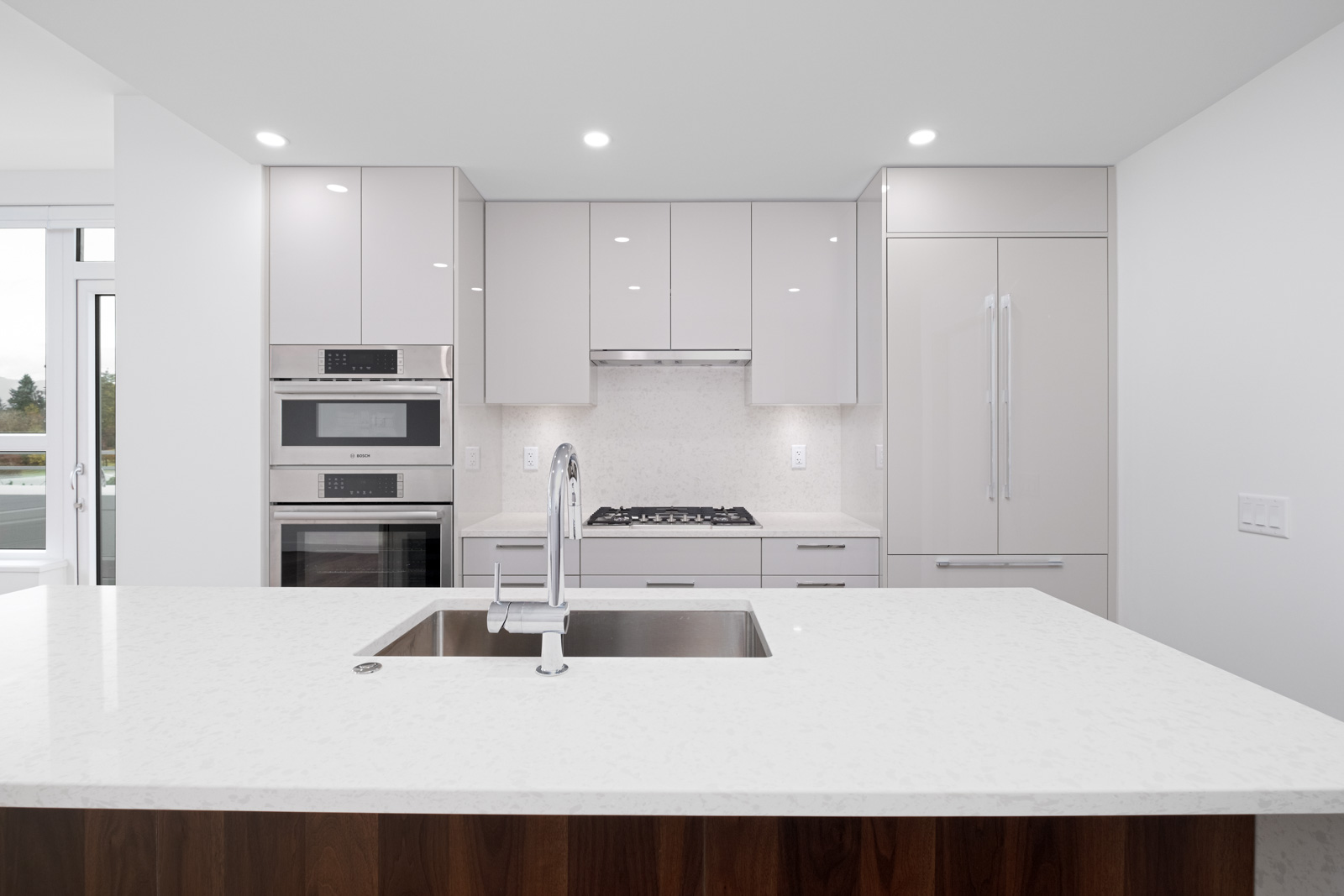 kitchen with quartz countertops in brand new rental condo apartment of basalt developed by pennyfarthing homes in vancouver westside