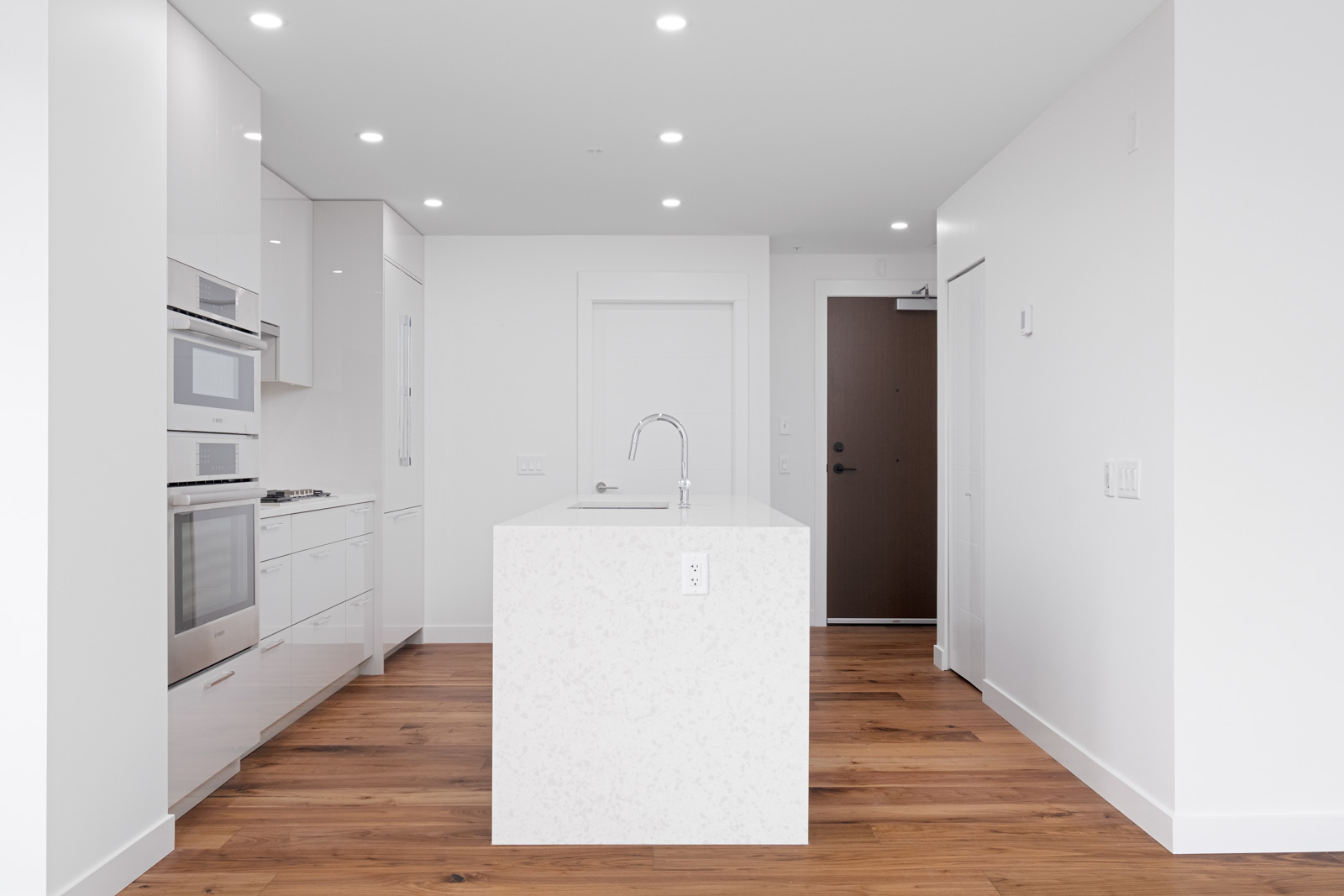 kitchen with island and white quartz countertop in rental condo apartment managed by bird nest properties in vancouver westside