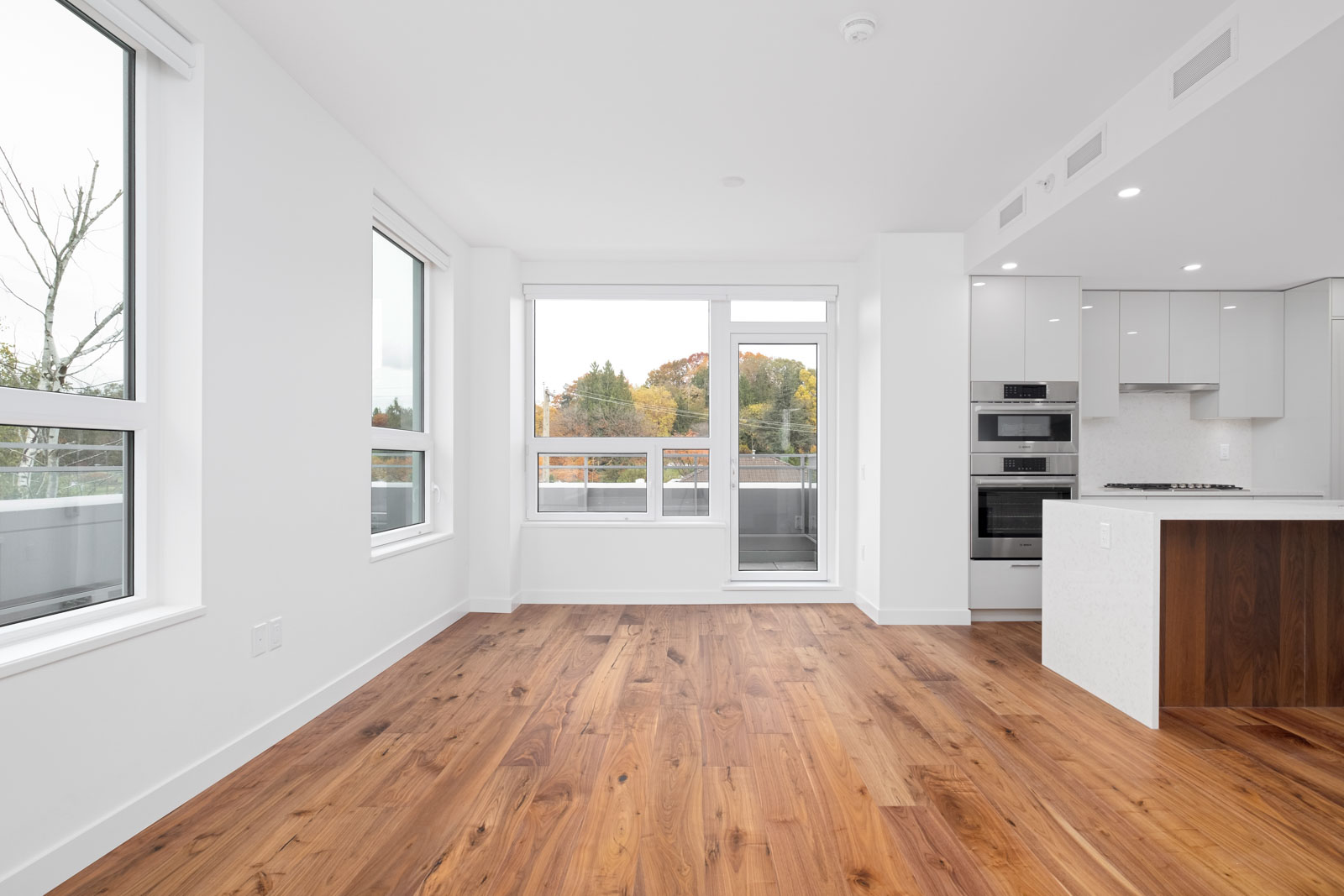 living room with windows and hardwood floors in vancouver westside rental condo managed by birds nest properties