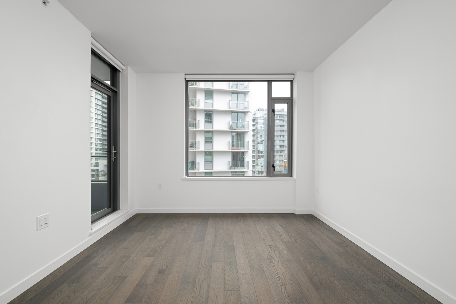 living room with hardwood floors and outdoor window in false creek olympic village rental condo managed by birds nest properties
