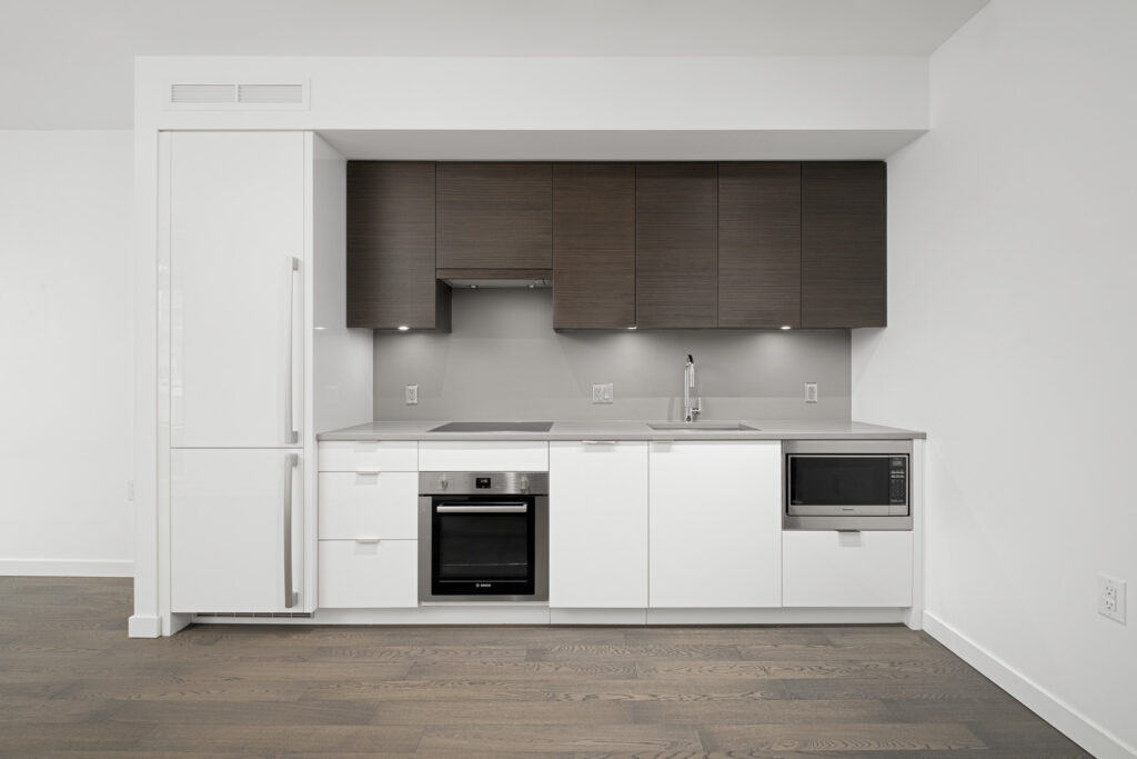 kitchen with dark cabinets and white countertop in rental condo in navio on pullman porter street in false creek olympic village