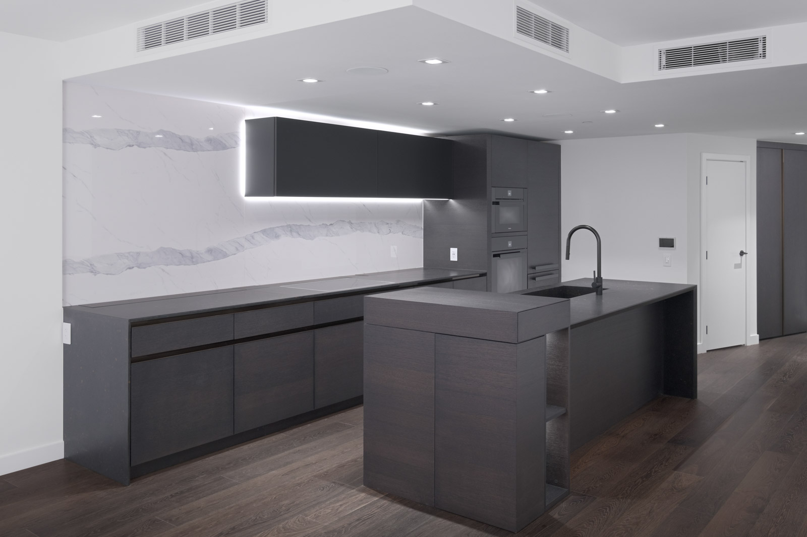 kitchen with dark cabinets at cardero building in coal harour managed by birds nest properties