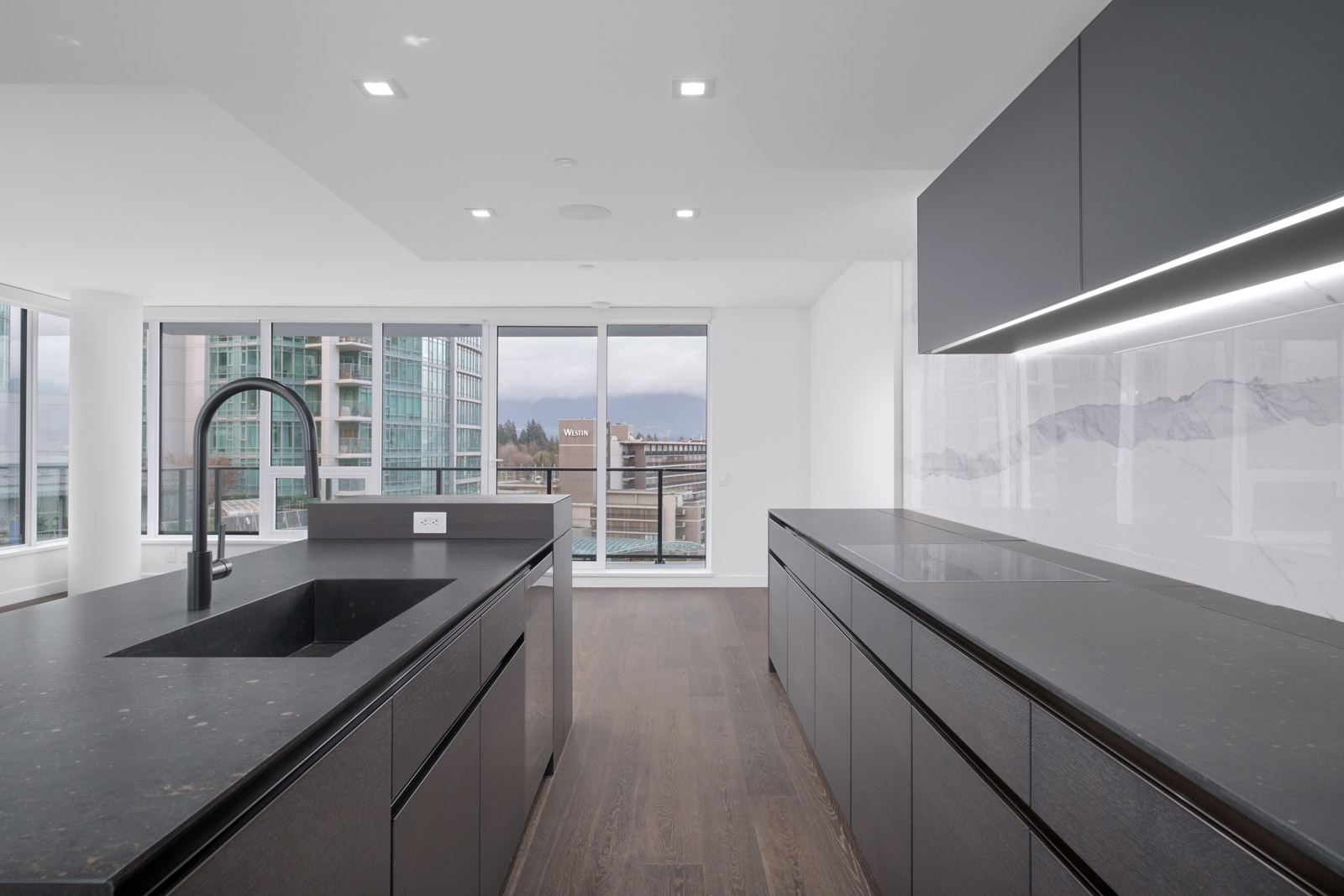 kitchen with long island and cabinets in cardero in coal harbour neighbourhood of downtown vancouver managed by birds nest properties