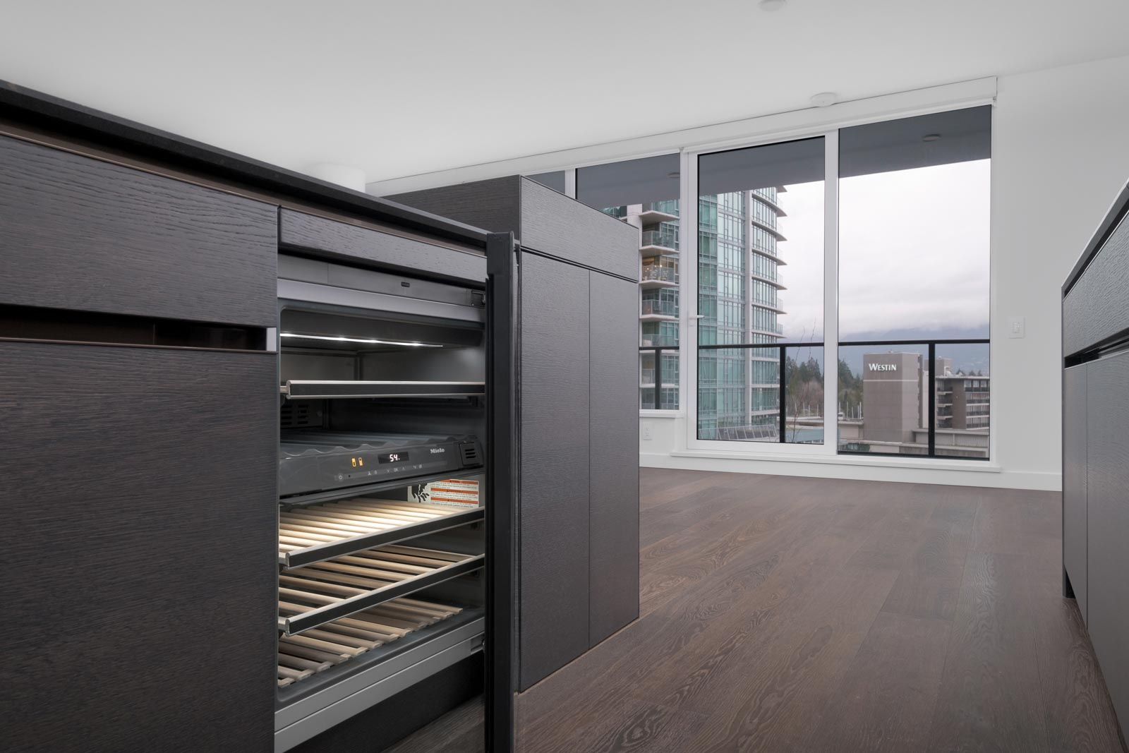 open shelving with dark cabinet doors in living room of rental condo at the cardero in coal harbour managed by birds nest properties