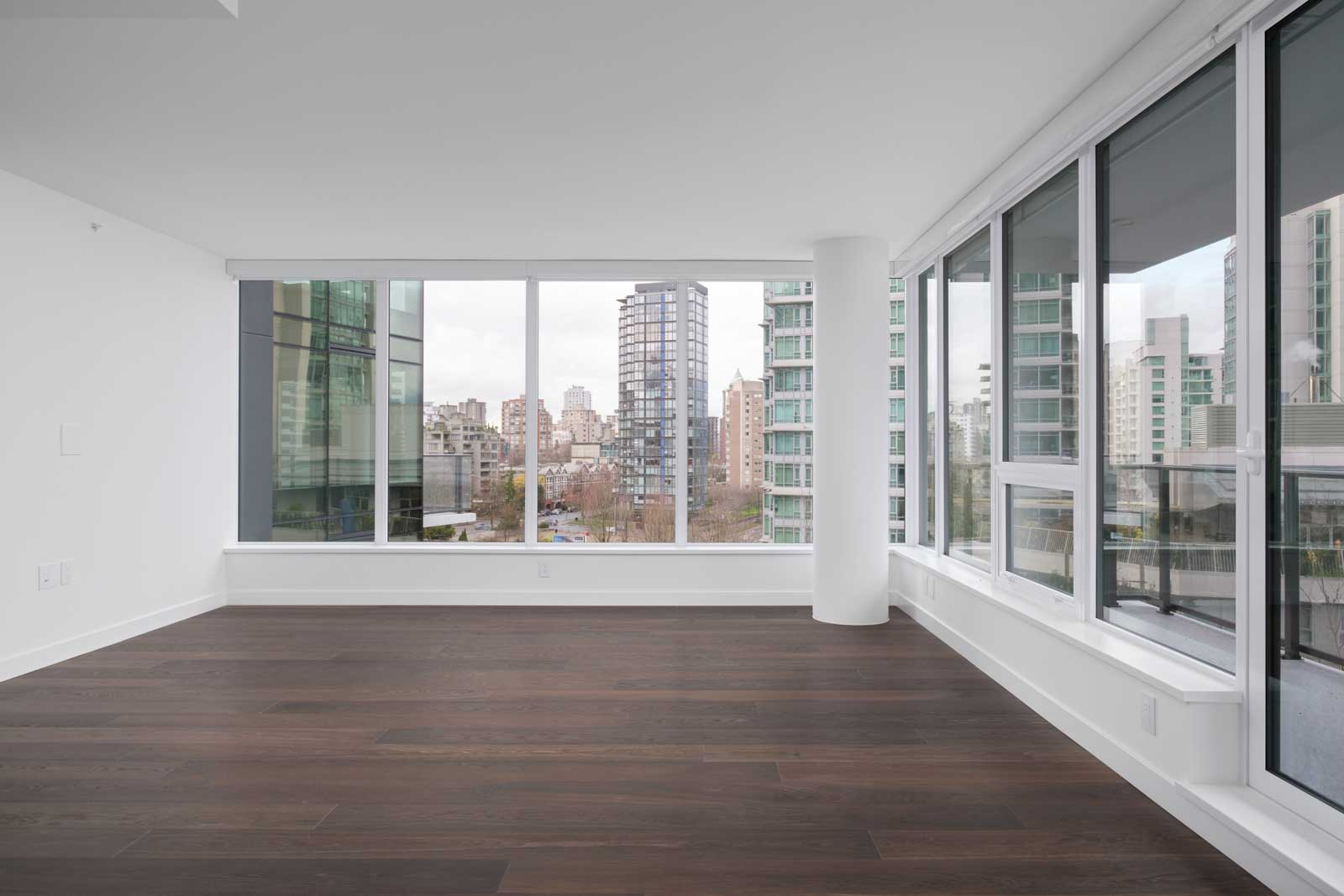 living room with dark hardwood flooring and wide windows in luxury rental condo at cardero