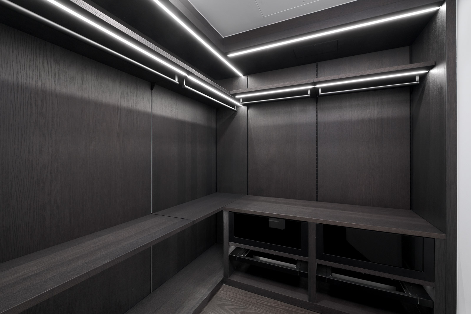 walk in closet with dark walls and led lights in rental condo at the cardero in downtown vancouver