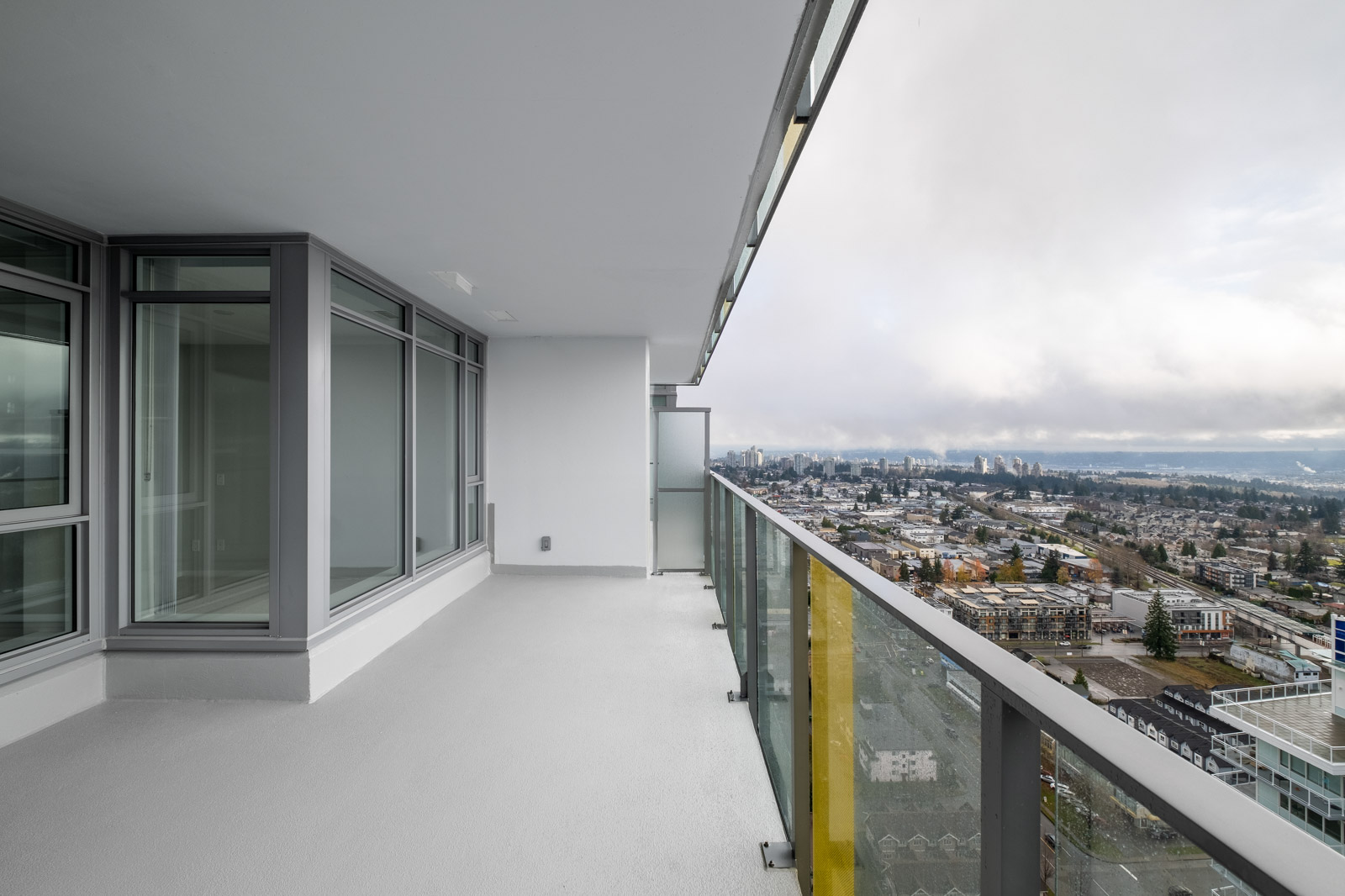 balcony with view of clear skies in rental condo in the Metrotown neighbourhood of Burnaby