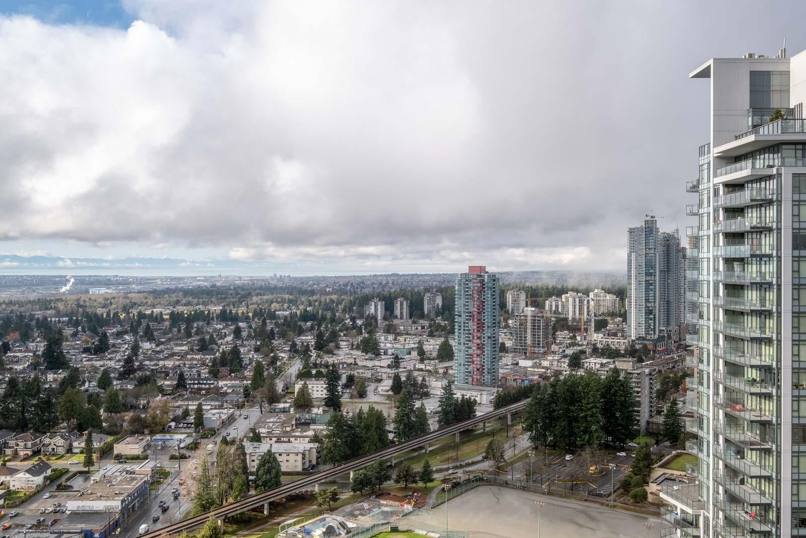 view of cloudy skies towards mount baker in rental condo in the Metrotown neighbourhood of Burnaby