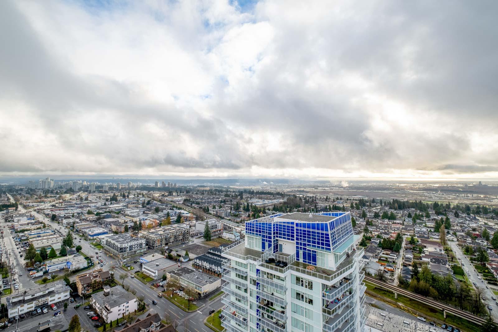view of buildings and cloudy skies towards mount baker in rental condo in the Metrotown neighbourhood of Burnaby