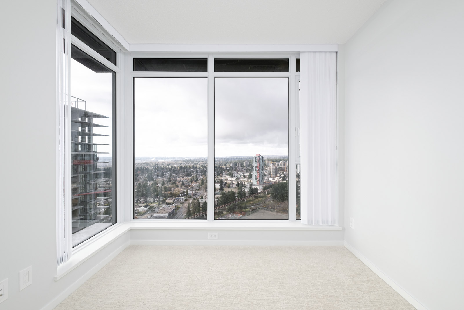 bedroom with white walls and window in rental condo at Vittorio in the Metrotown neighbourhood of Burnaby managed by Birds Nest Properties