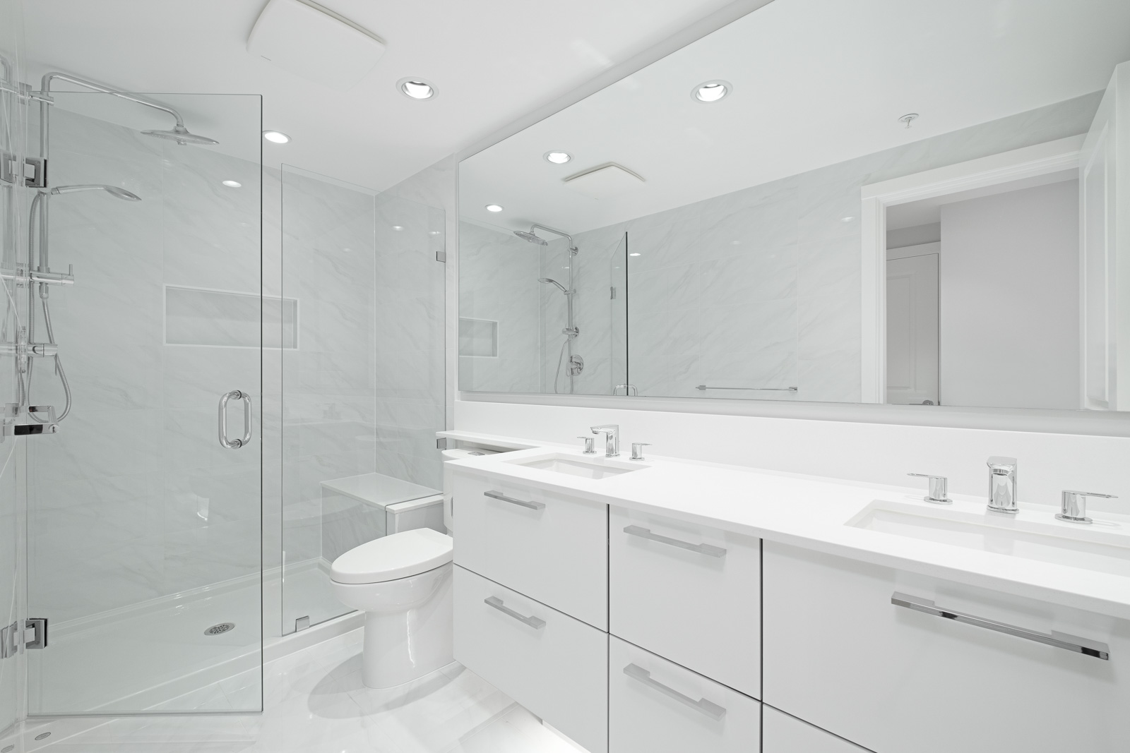bathroom with white vanity and mirrors in rental condo at vittorio in the Metrotown neighbourhood of Burnaby