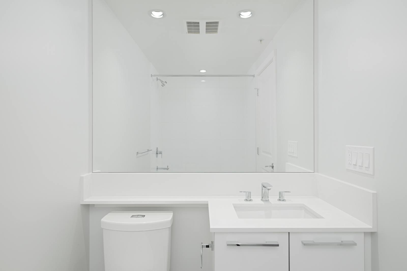 bathroom with white vanity and mirrors in rental condo managed by birds nest properties at vittorio in the Metrotown neighbourhood of Burnaby