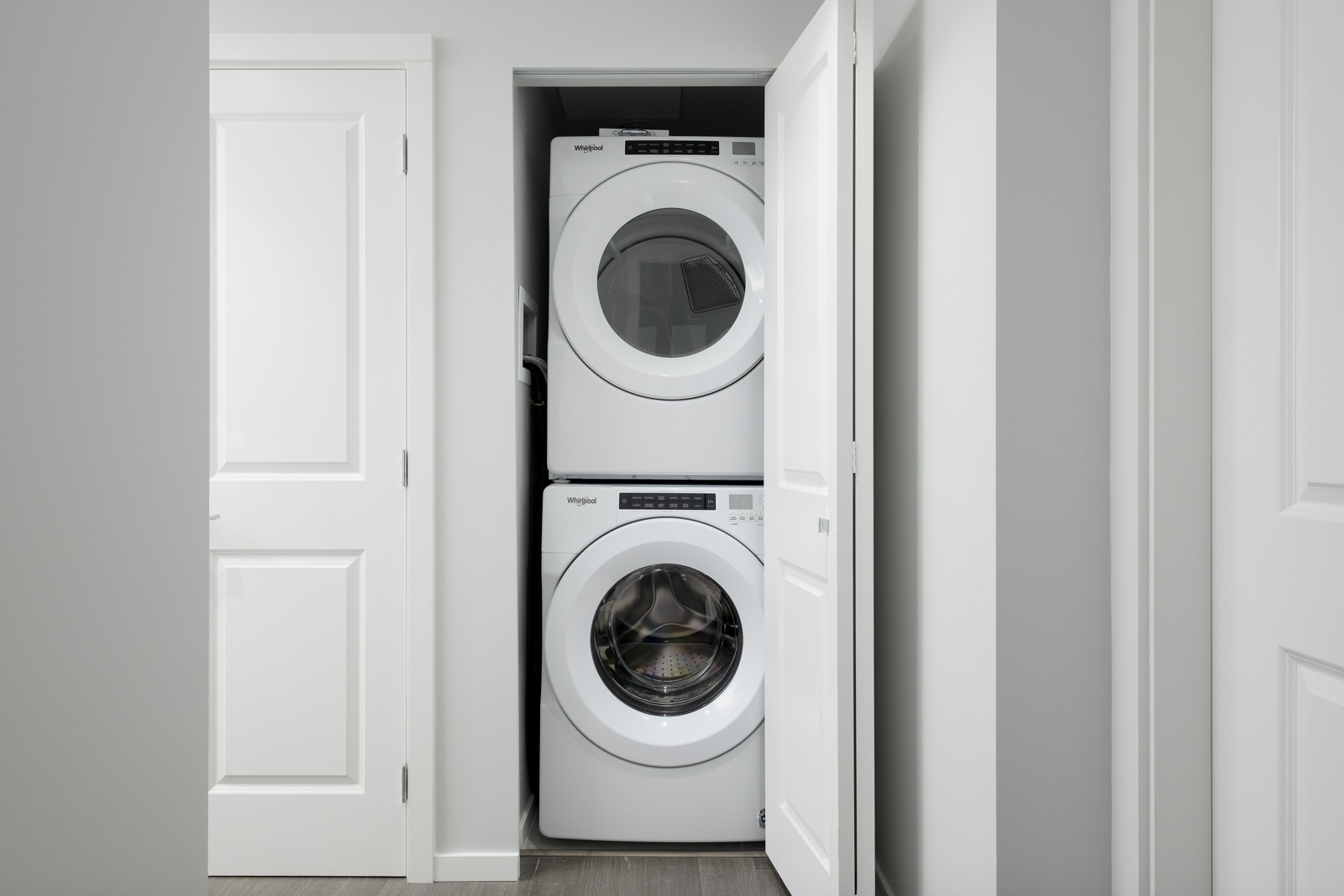 stacked white washer and dryer in rental condo presented by birds nest properties at vittorio by polygon in metrotown burnaby