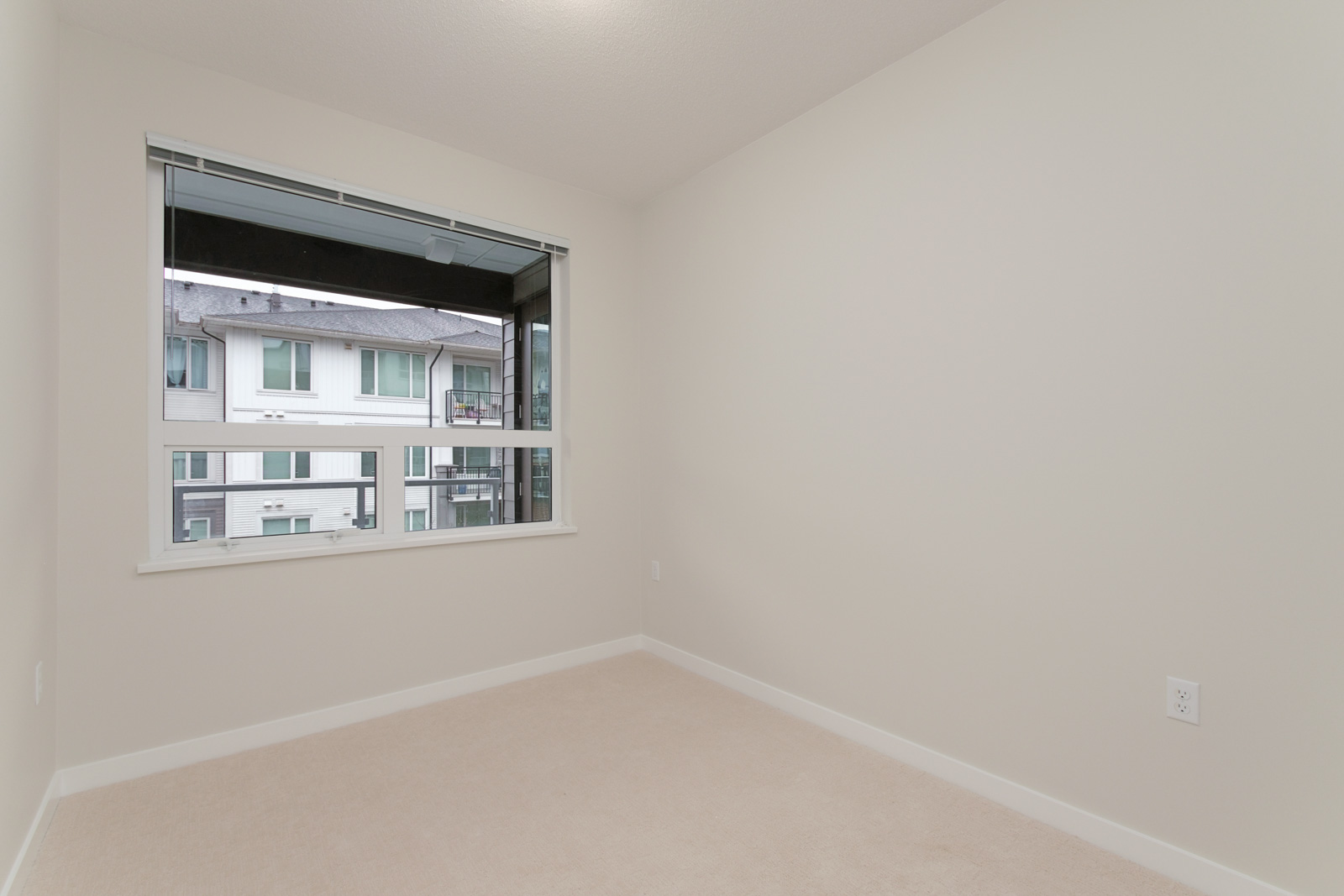 corner of bedroom with window on left in rental condo in berkeley house by polygon in richmond bc