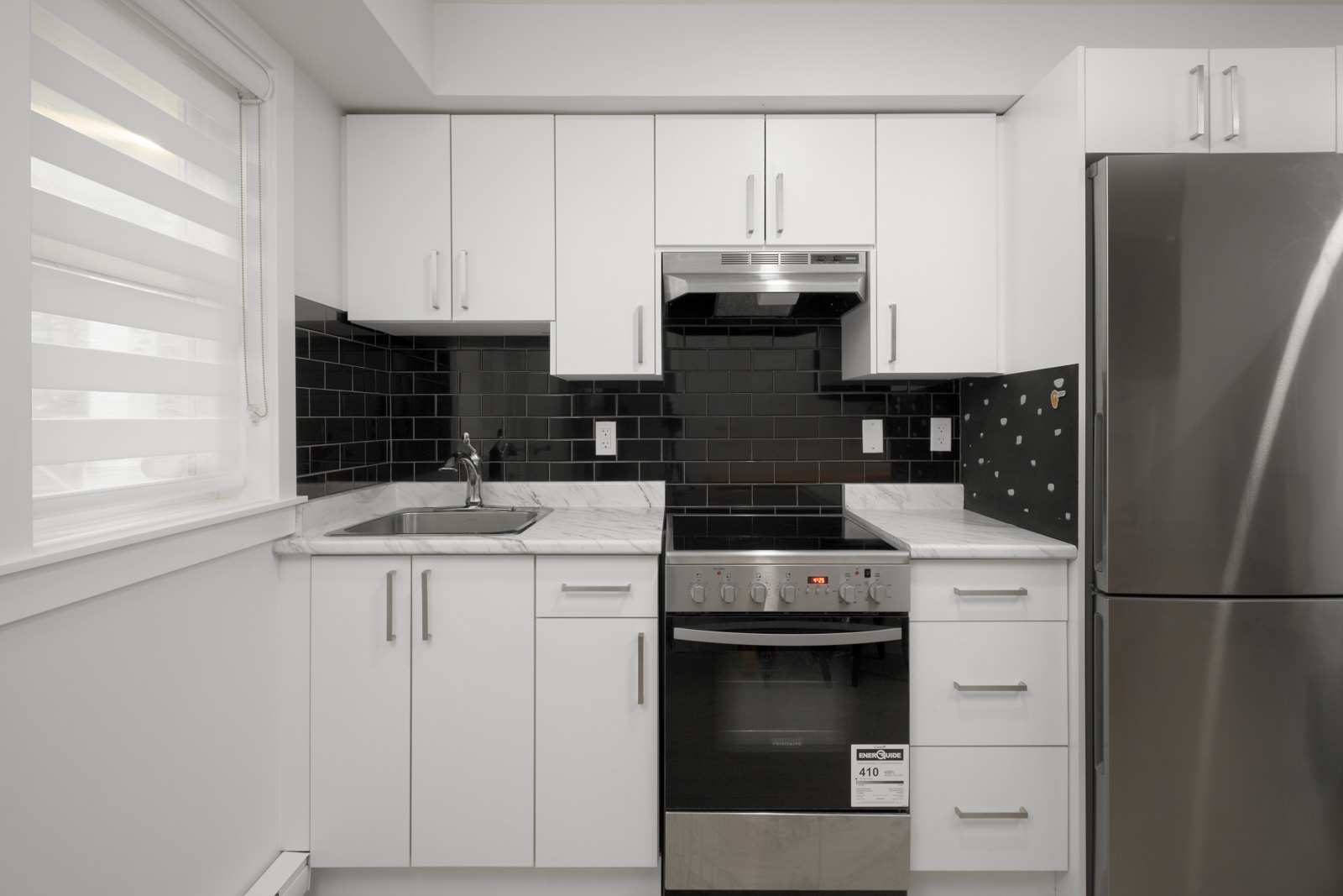 kitchen in rental condo with Birds Nest Properties property management in east vancouver