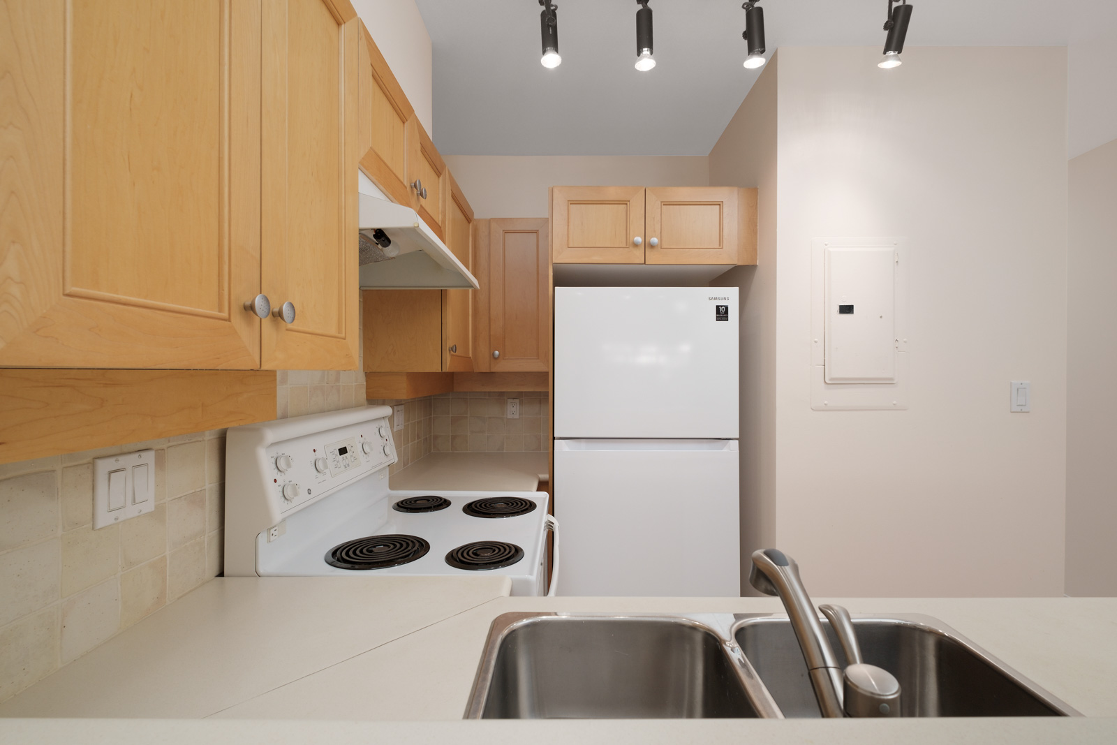 kitchen with white stove in kitsilano rental studio apartment in vancouver westside