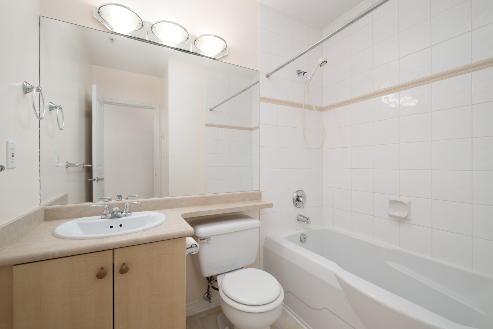 bathroom with vanity on left and bathtub on right in kitsilano rental studio apartment in vancouver westside