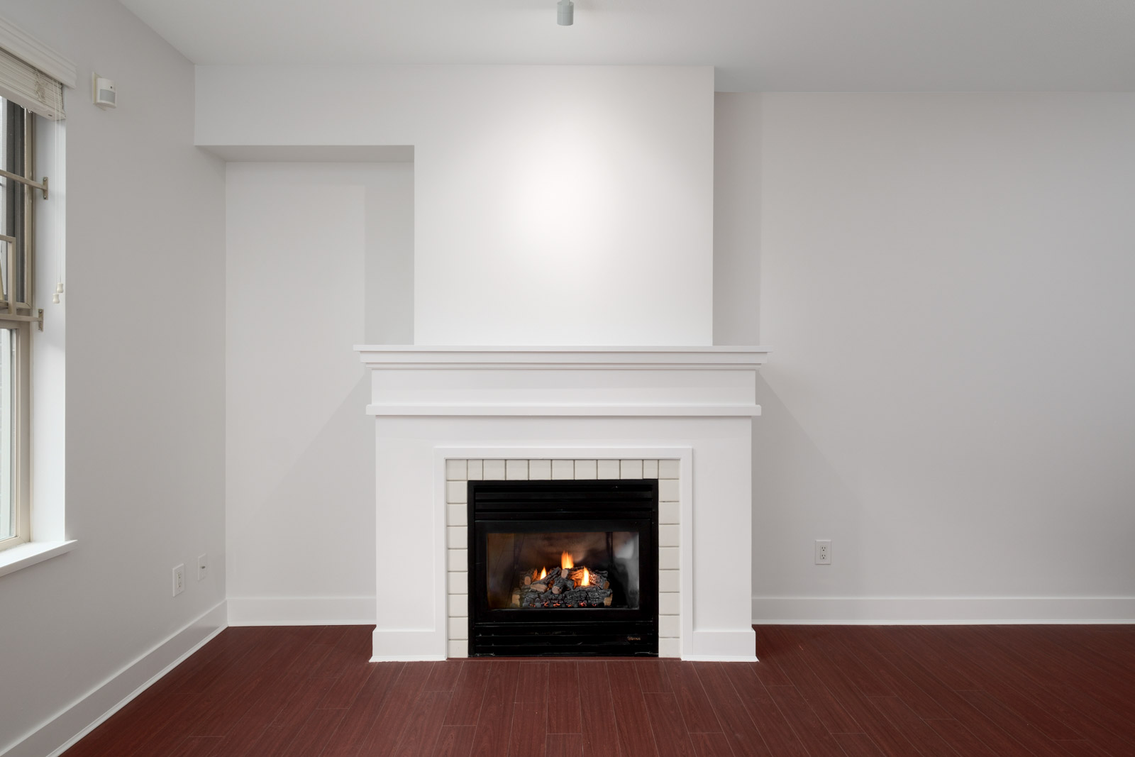 gas fireplace with white walls in rental apartment at alexandra house near arbutus and king edward in vancouver westside