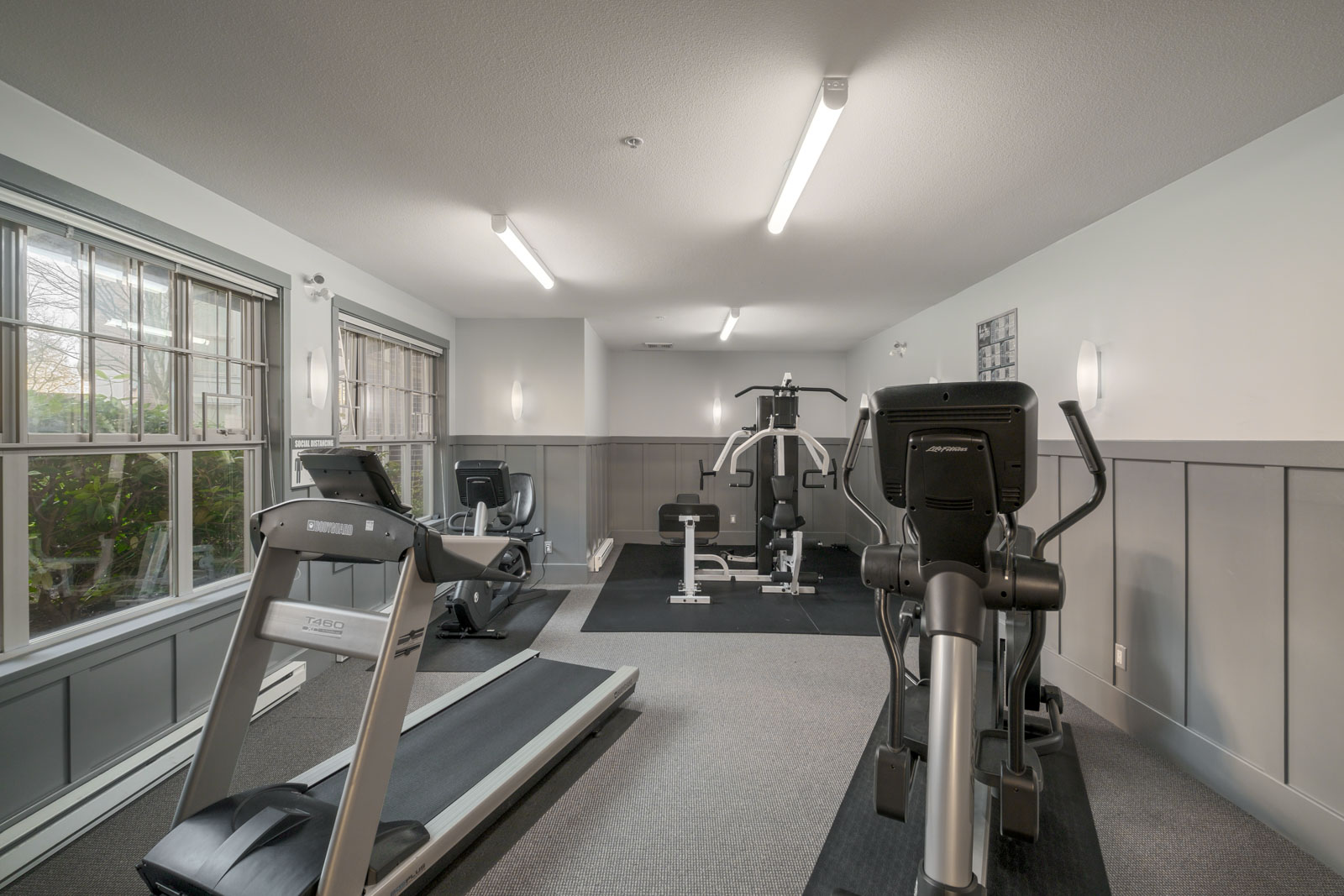 gym with treadmills and stationary bikes in alexandra house residential building in vancouver westside