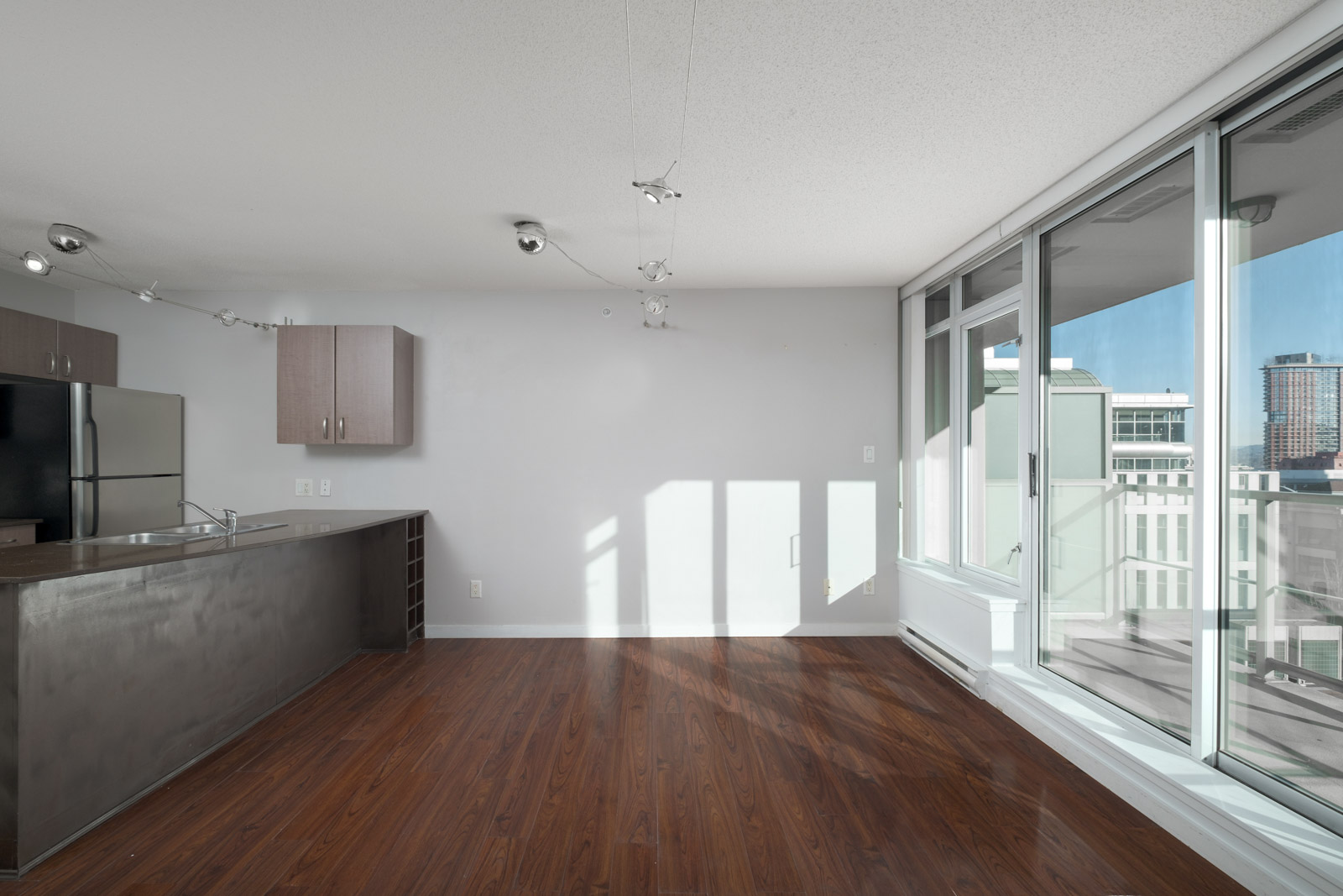 living room with hardwood floors in rental house in the downtown neighbourhood of vancouver