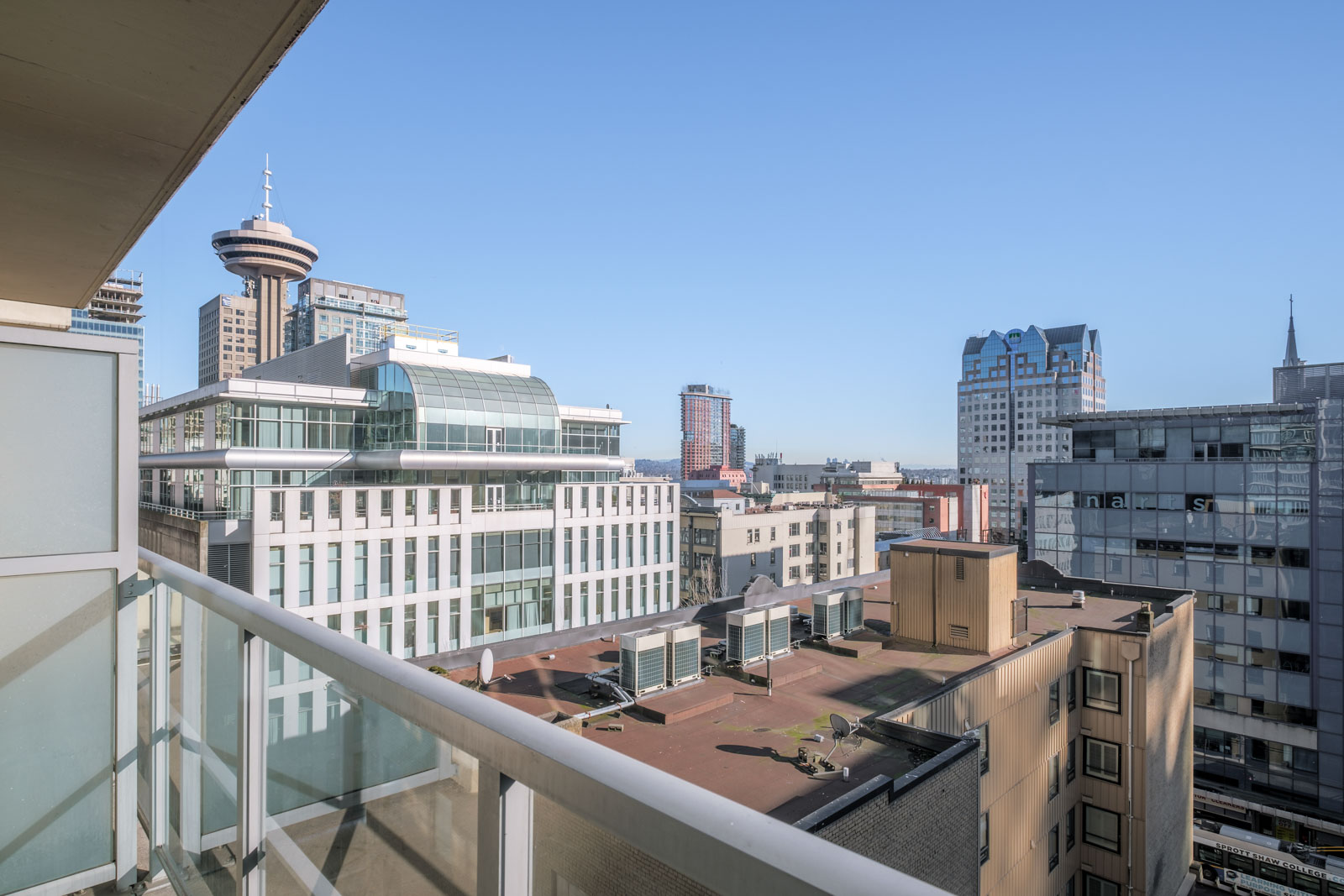 balcony with view of city life in rental condo in downtown neighbourhood Vancouver