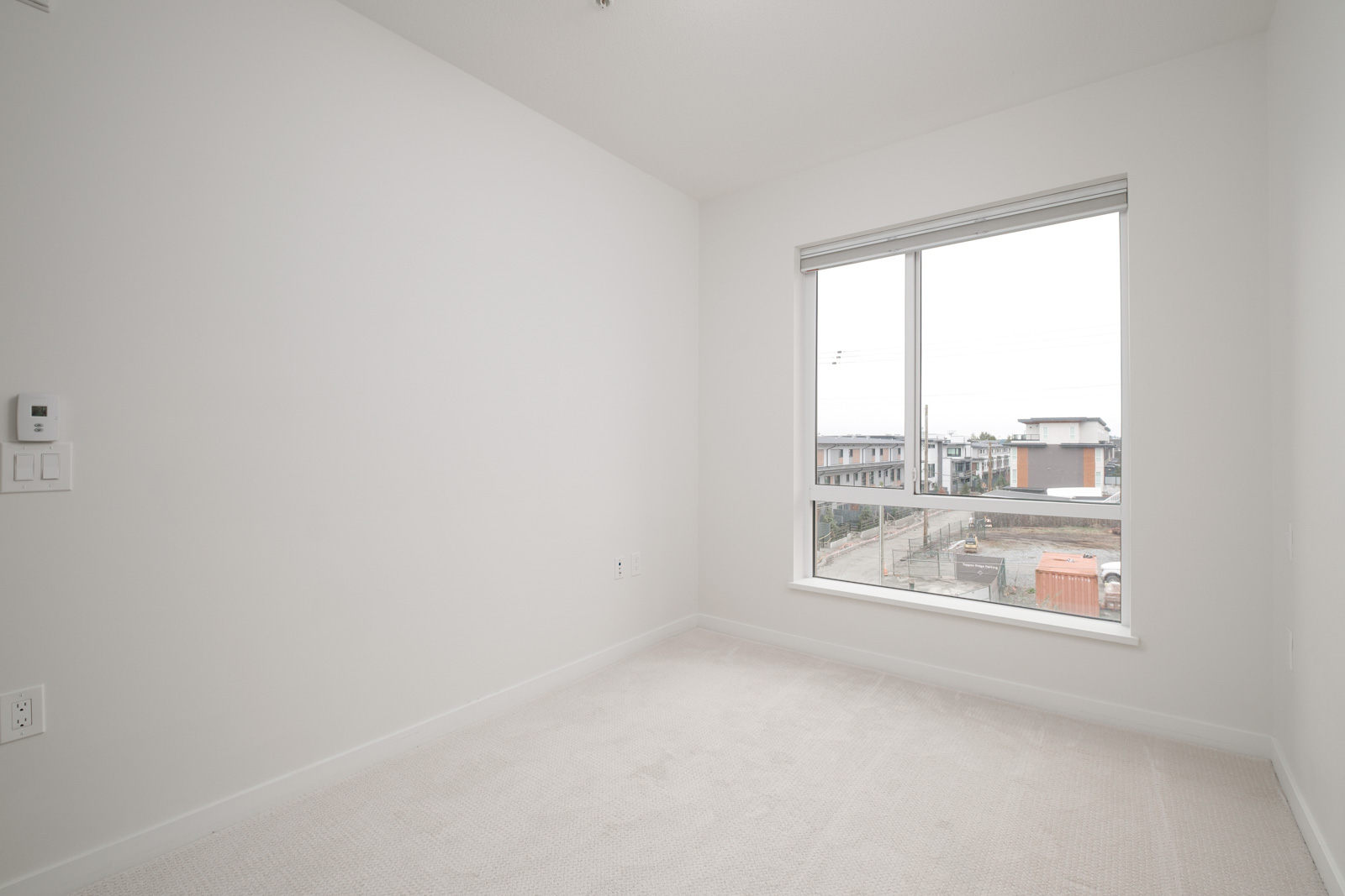 living room with view in rental condo at 205-615 East 3rd Street in North Vancouver