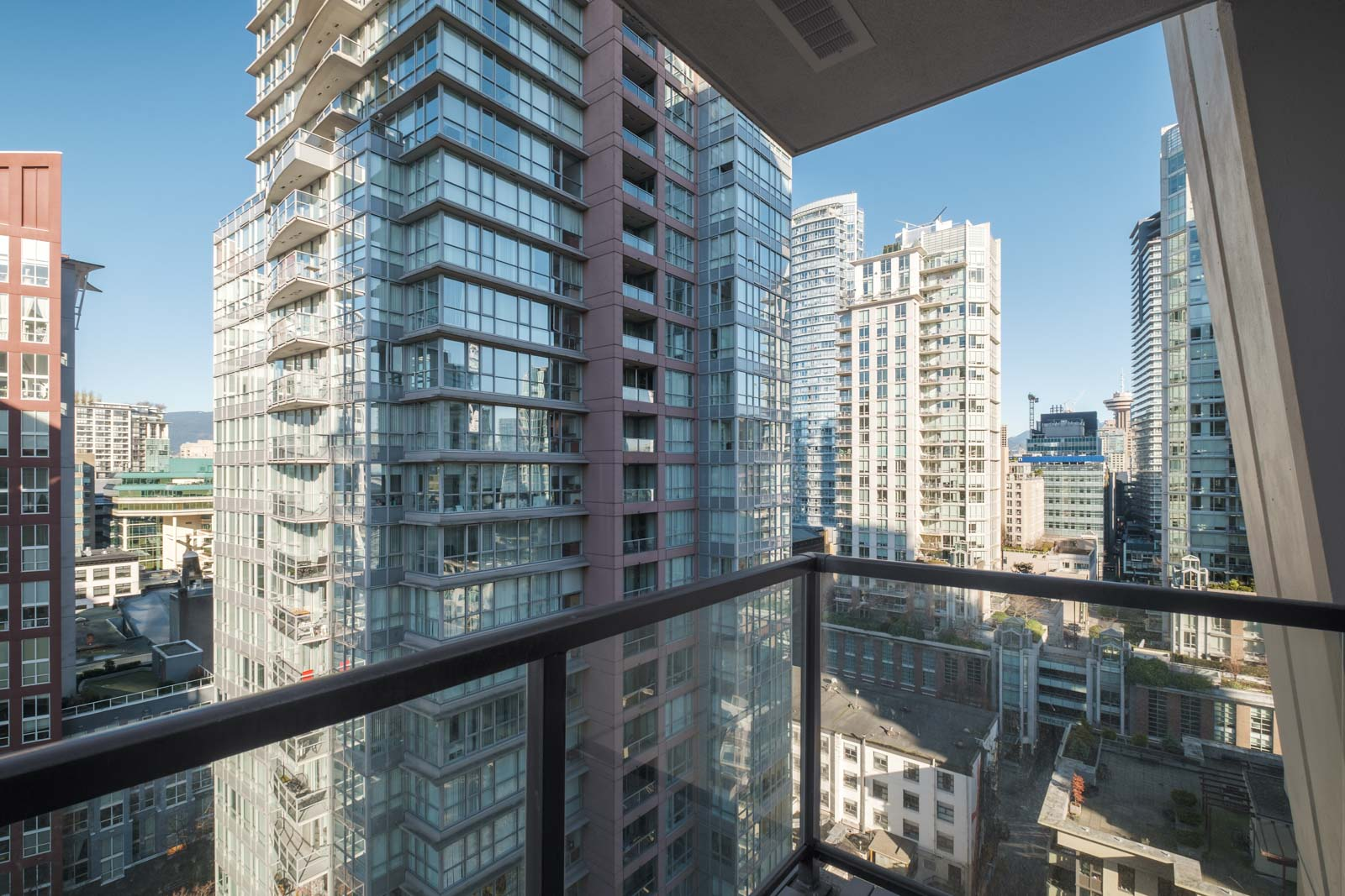 balcony with view of city life in rental condo in yaletown neighbourhood Vancouver