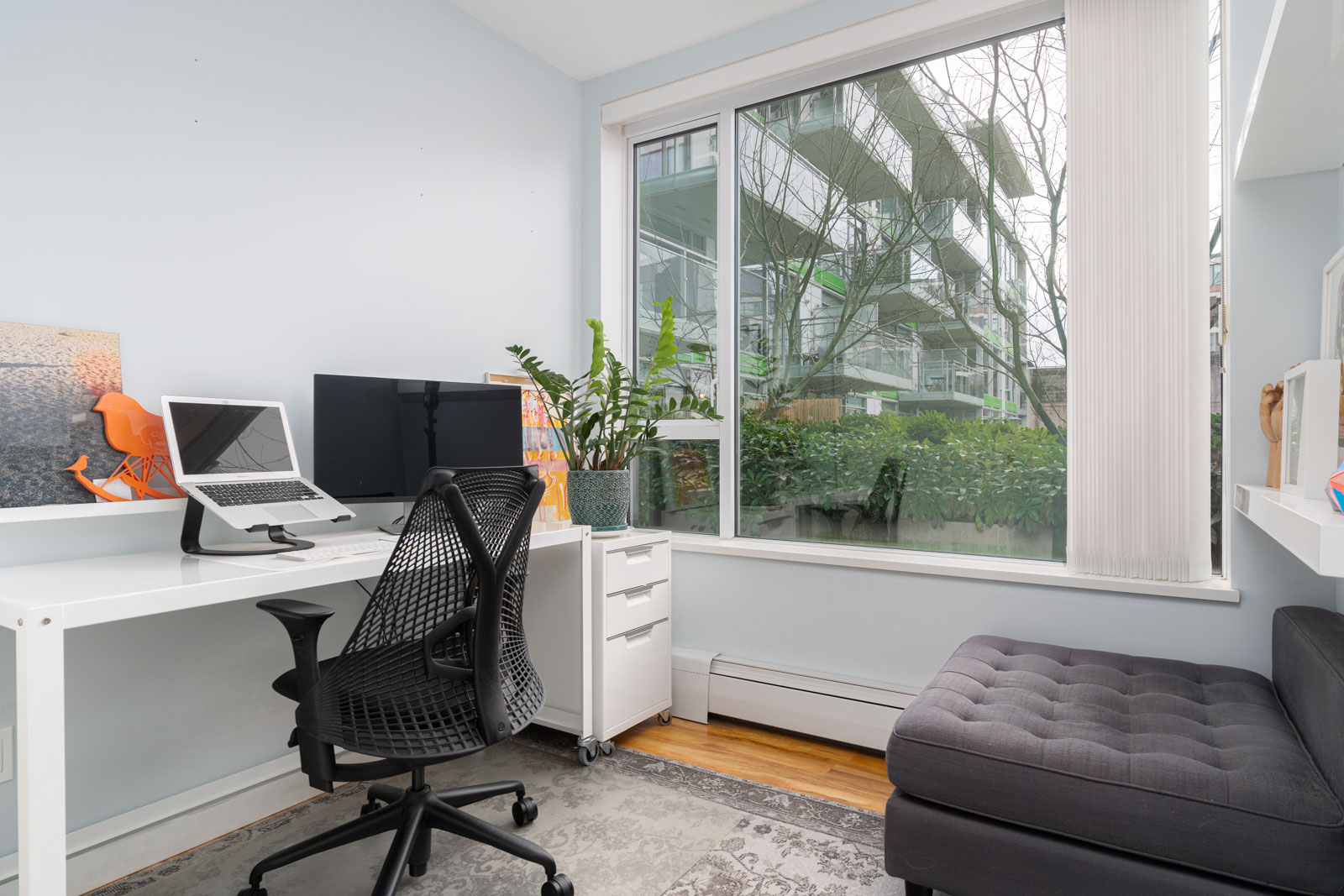 den with white walls and laminate floors and windows in rental house in Vancouver