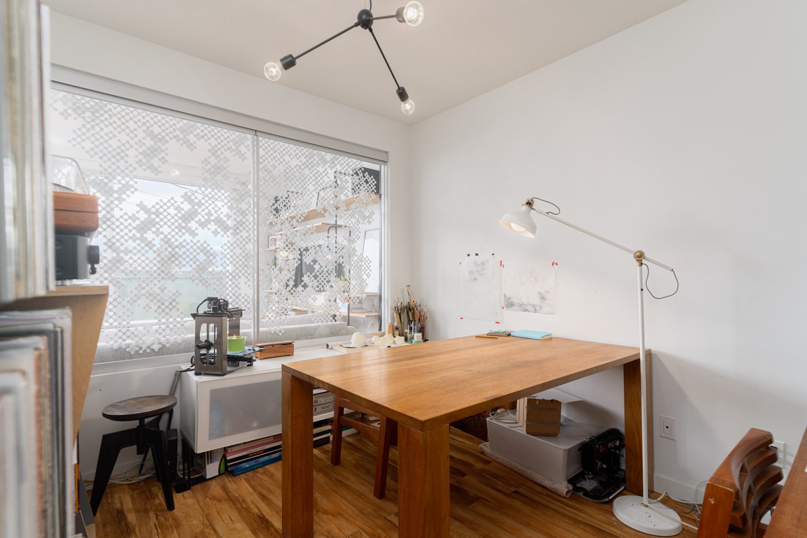 den with window view and white walls and laminate floors and windows in rental house in Vancouver