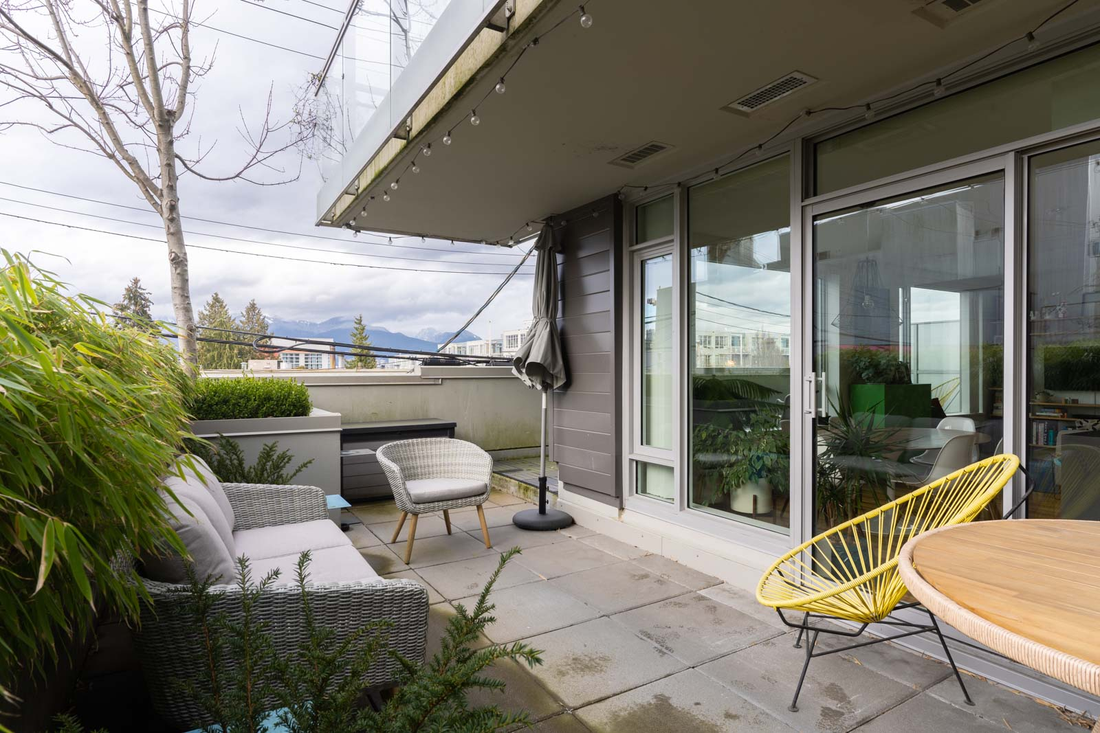balcony with view of city life in rental condo in Mount pleasant neighbourhood Vancouver