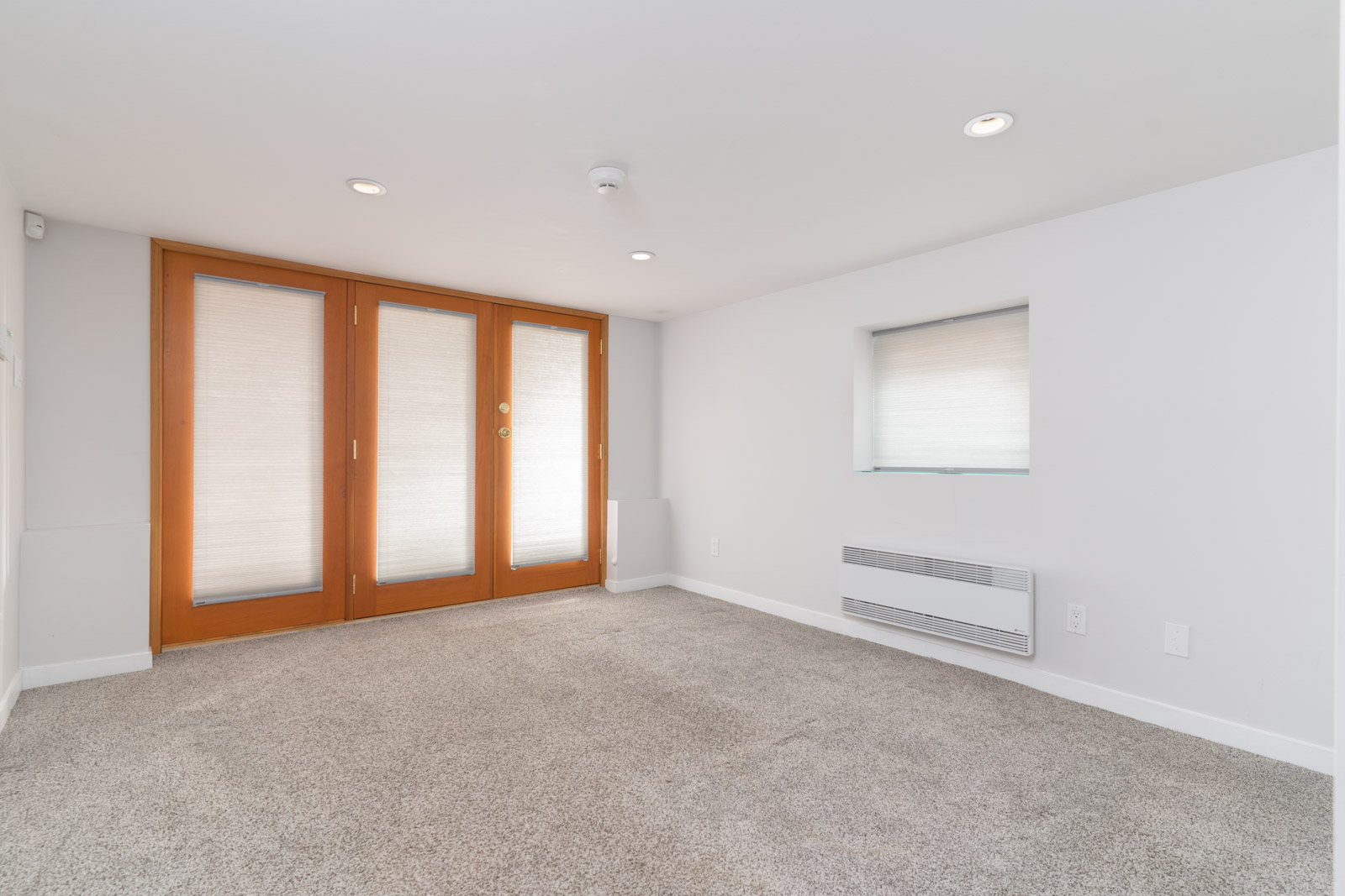 Wide bedroom with walk-in-closet in a basement home in Vancouver