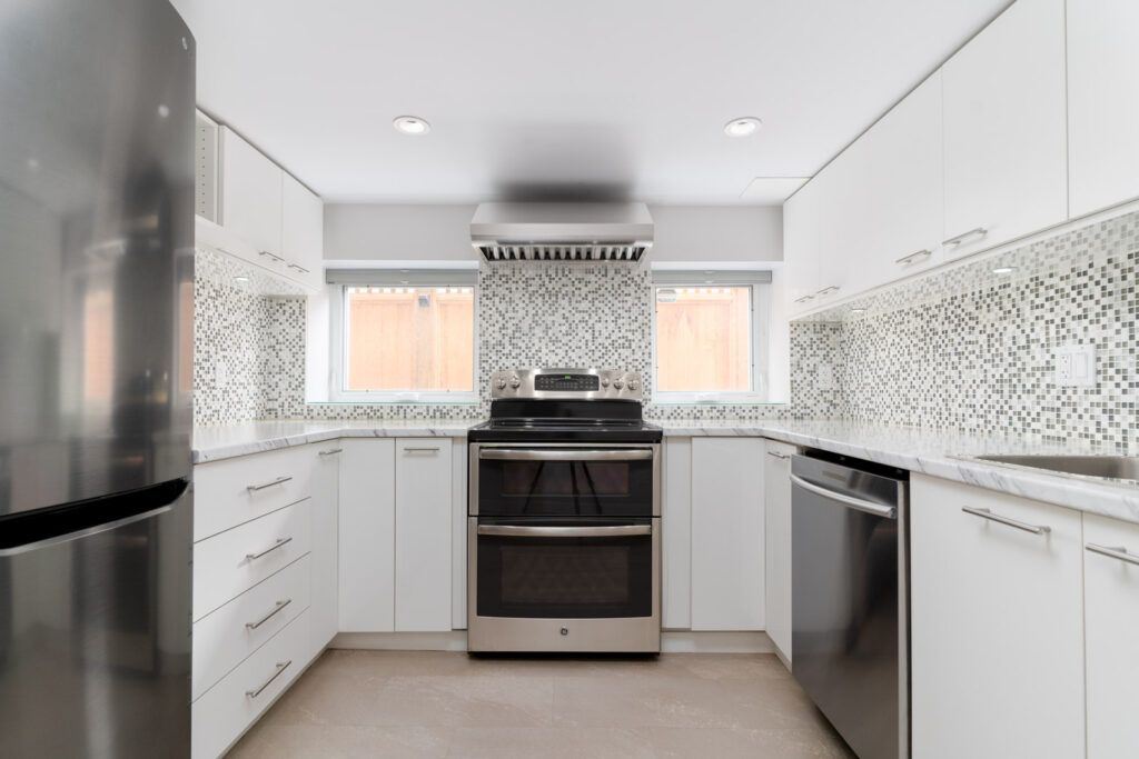 High end appliances in a beautiful basement suite managed Birds Nest Properties